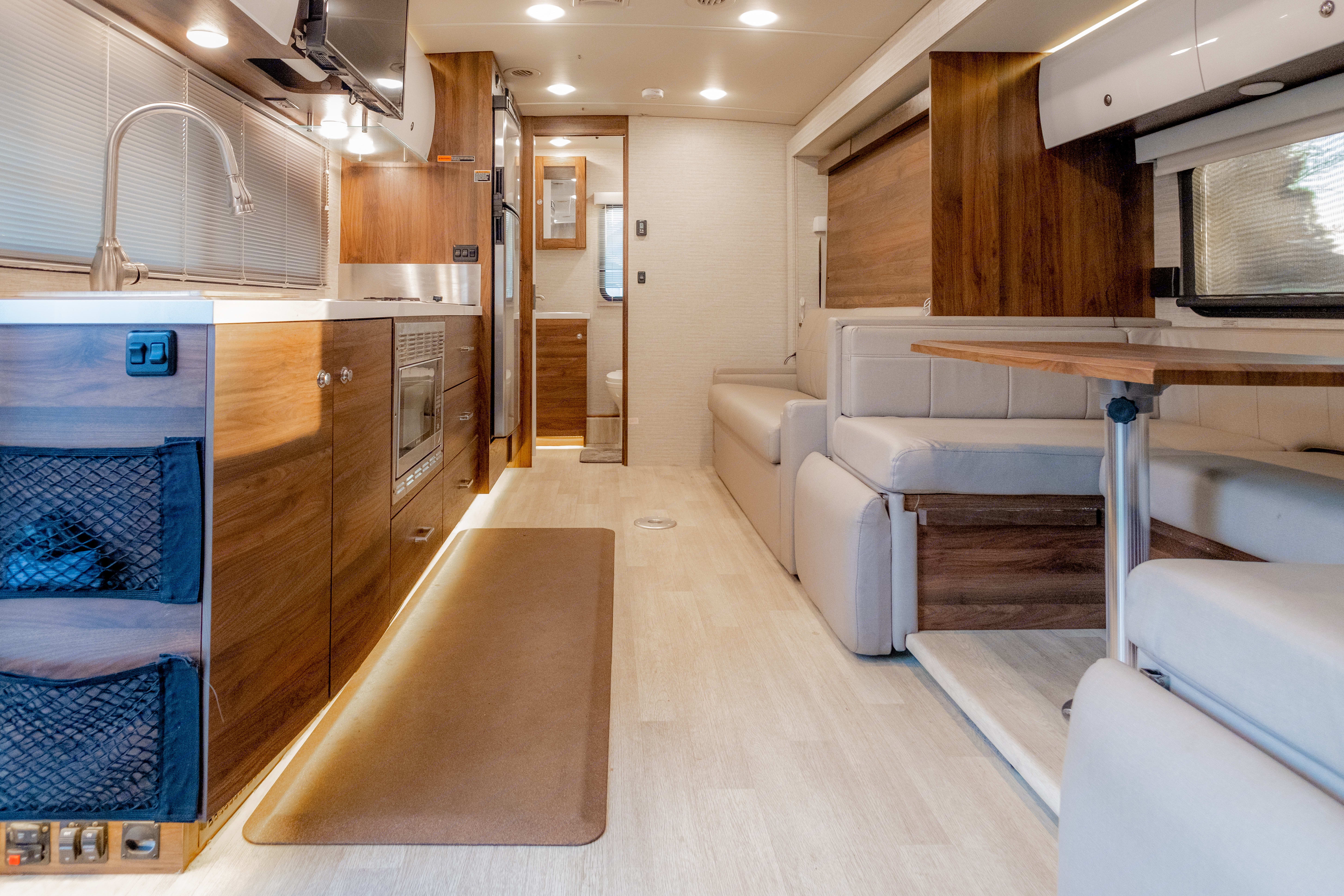 Very spacious with the slide out. You can also still use the kitchen with the slide in which I like when traveling with my 3 year old.. Winnebago Navion 24D 2020