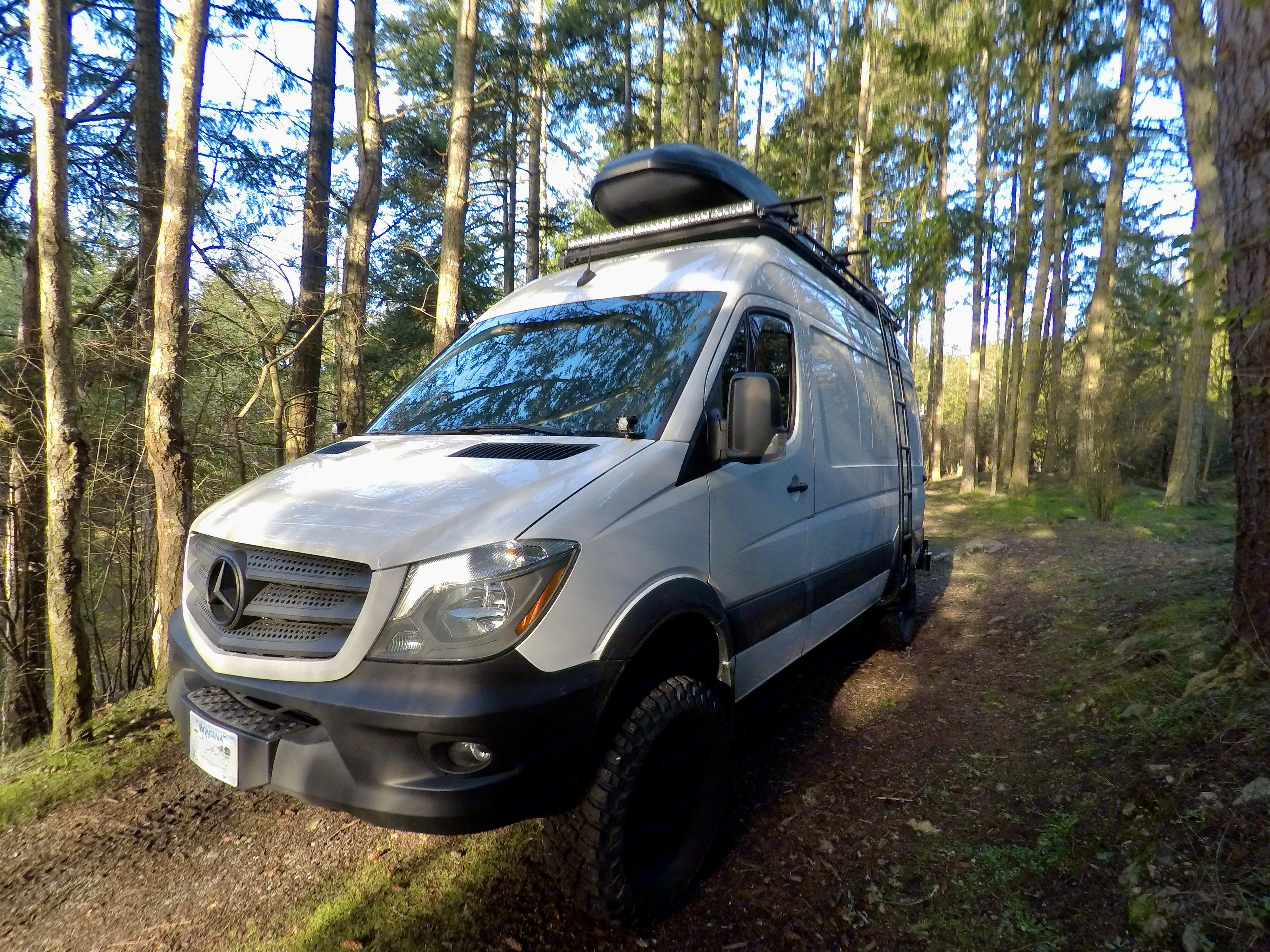 Lockable Yakima roof box accessed by driver-side ladder.. Mercedes-Benz Sprinter 2018