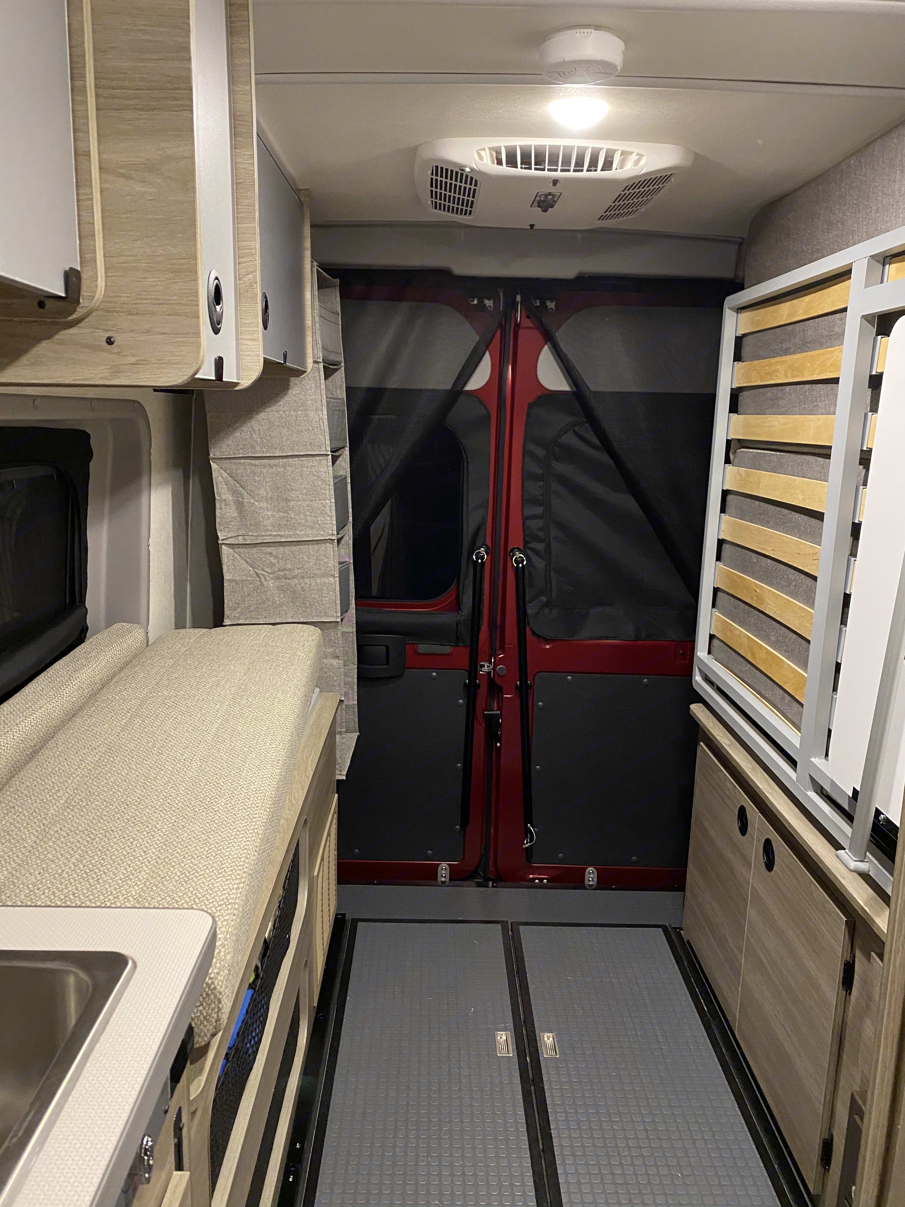 This is what the area looks like when the Murphy bed is up and locked.. Winnebago Solis 2021