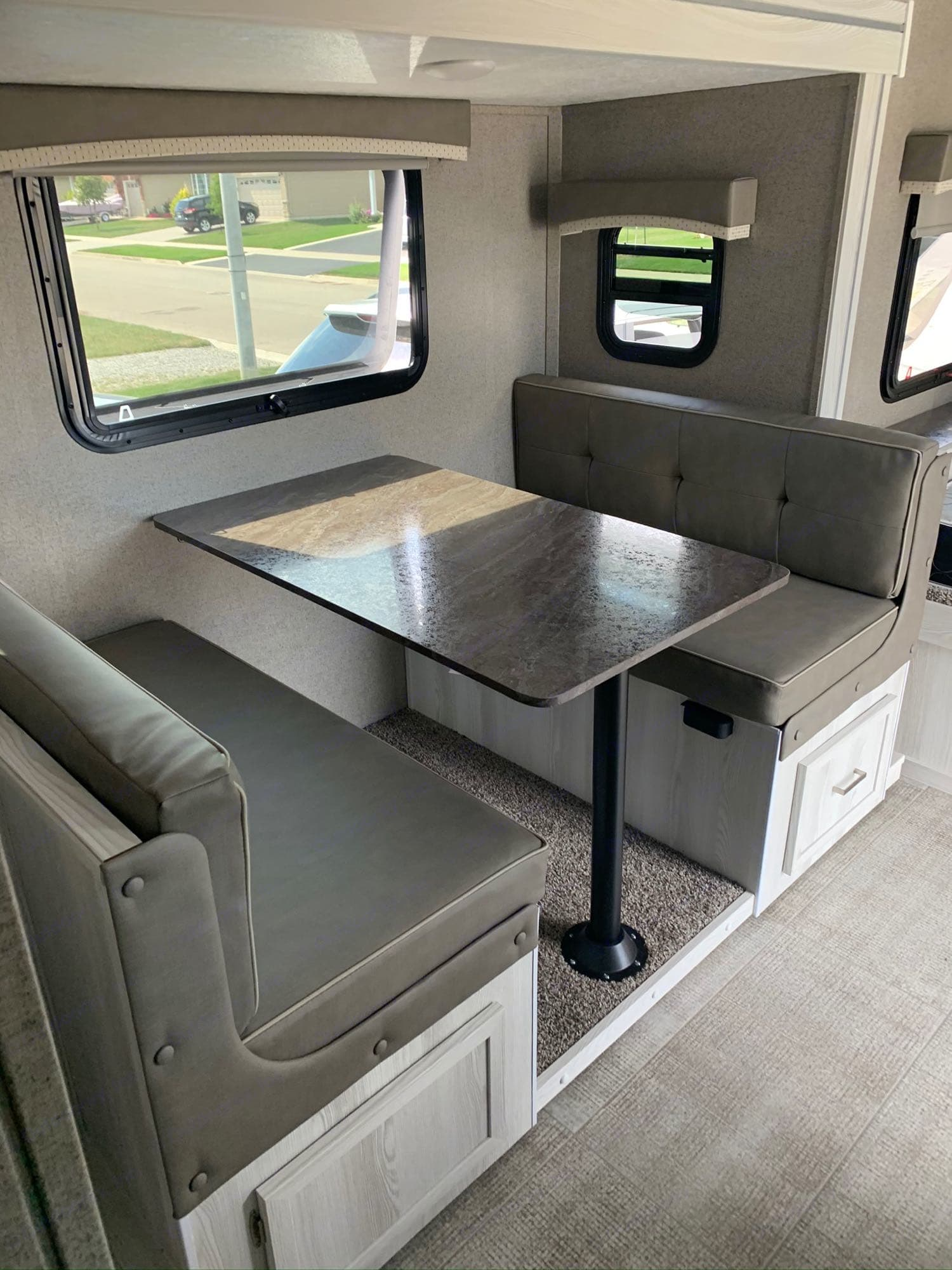 Seats 4 comfortably for dining or playing games. Turns into a double bed, with pull down shades. A perfect spot under the table for your dog to sleep.. Forest River Rockwood 2020