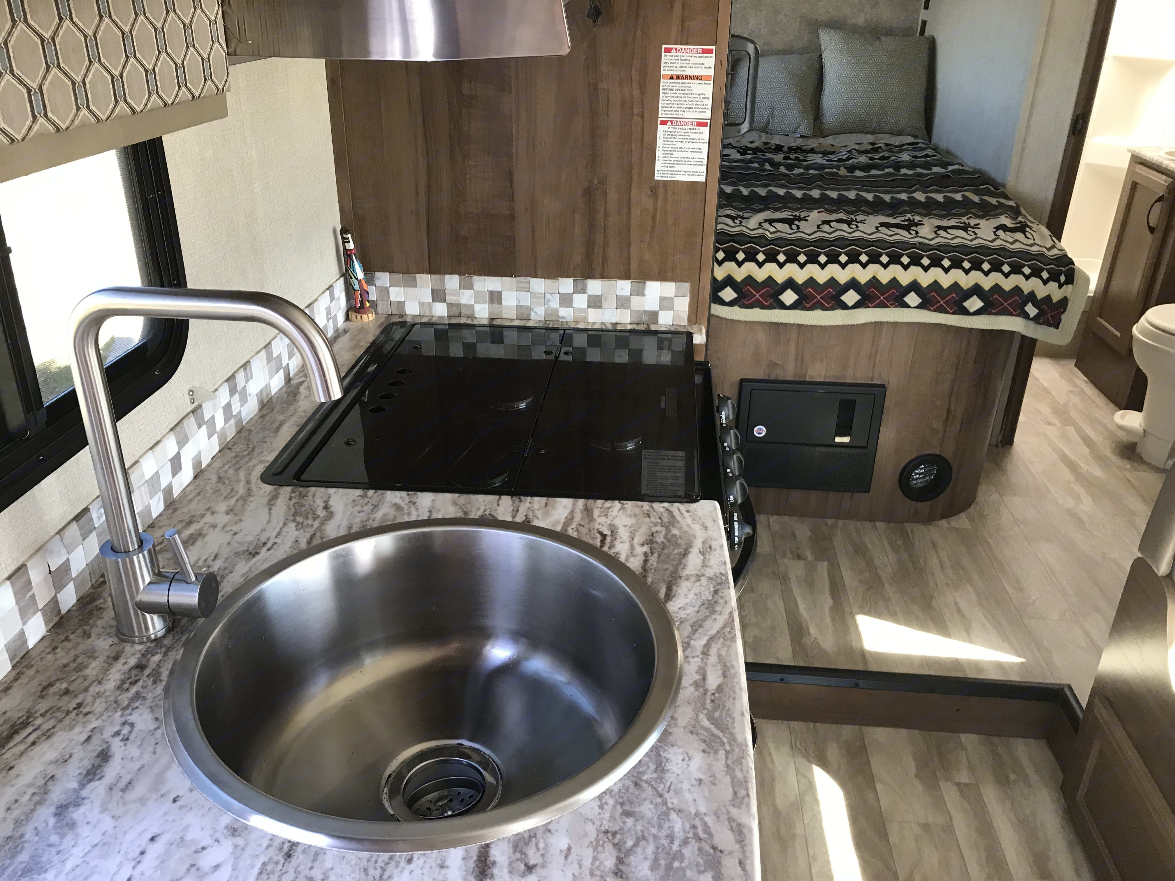3 burner gas stove, good size sink to clean up. . Gulf Stream Conquest 2019
