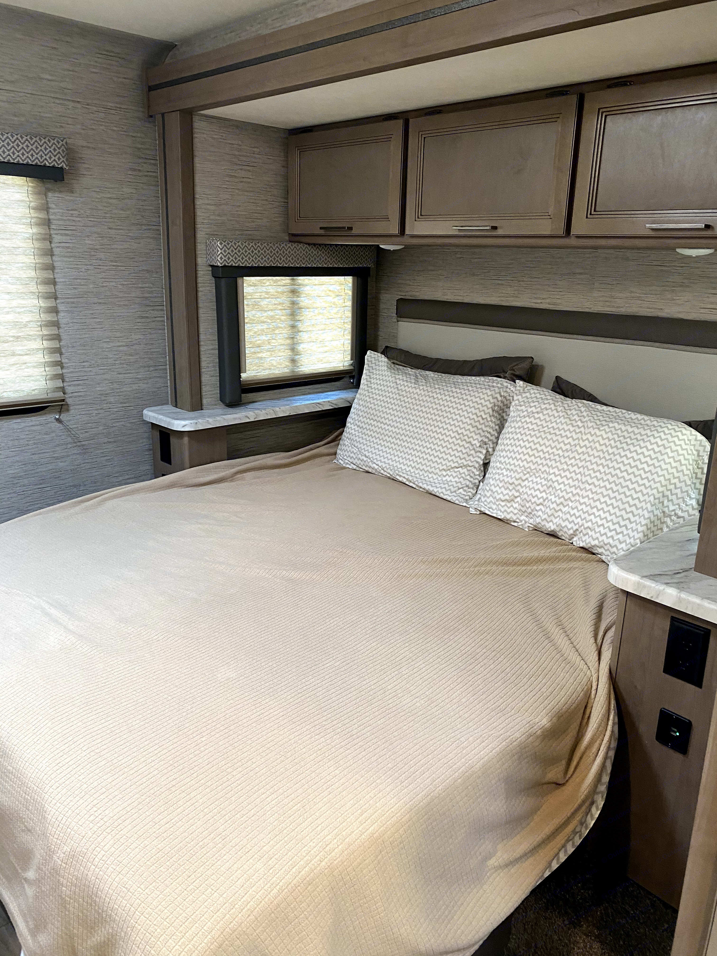 Queen bed on a slide.. Thor Motor Coach Freedom Elite 2021