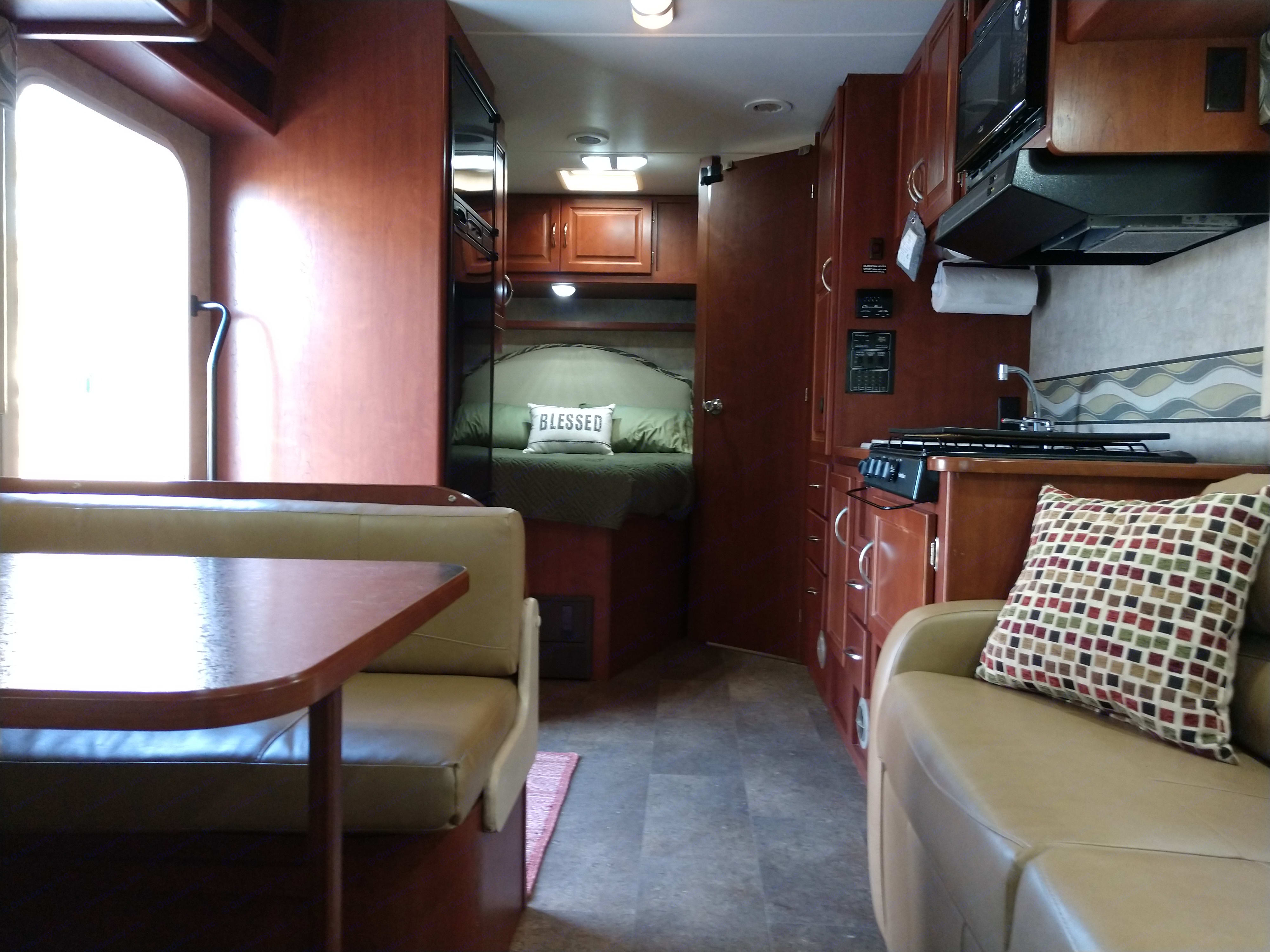 Here we have a shot of the jack-knife sofa on the right and the dinette on the left.. Itasca Spirit 2014