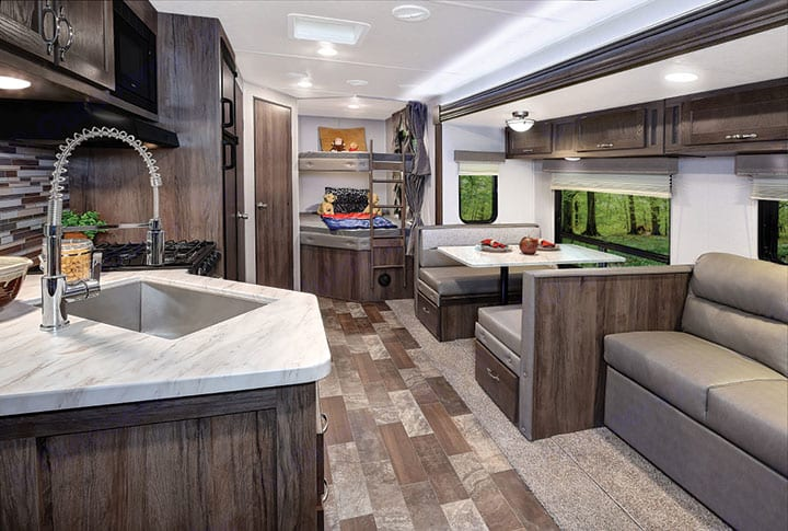 View of the Living, Dining, Bunks & bathroom from the front of the camper.. Forest River Springdale 2020