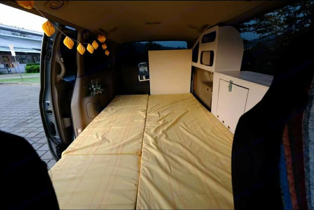 Bed from the driver's seat. Toyota Sienna (Converted) 2000