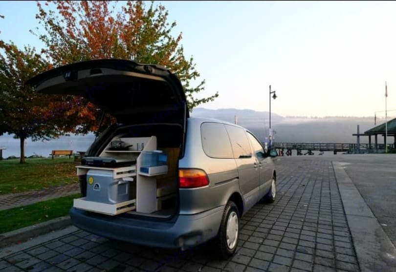The storage unit can be easily pulled out when the trunk of the car is lifted. Will house cool box, kitchen supplies and stove. . Toyota Sienna (Converted) 2000