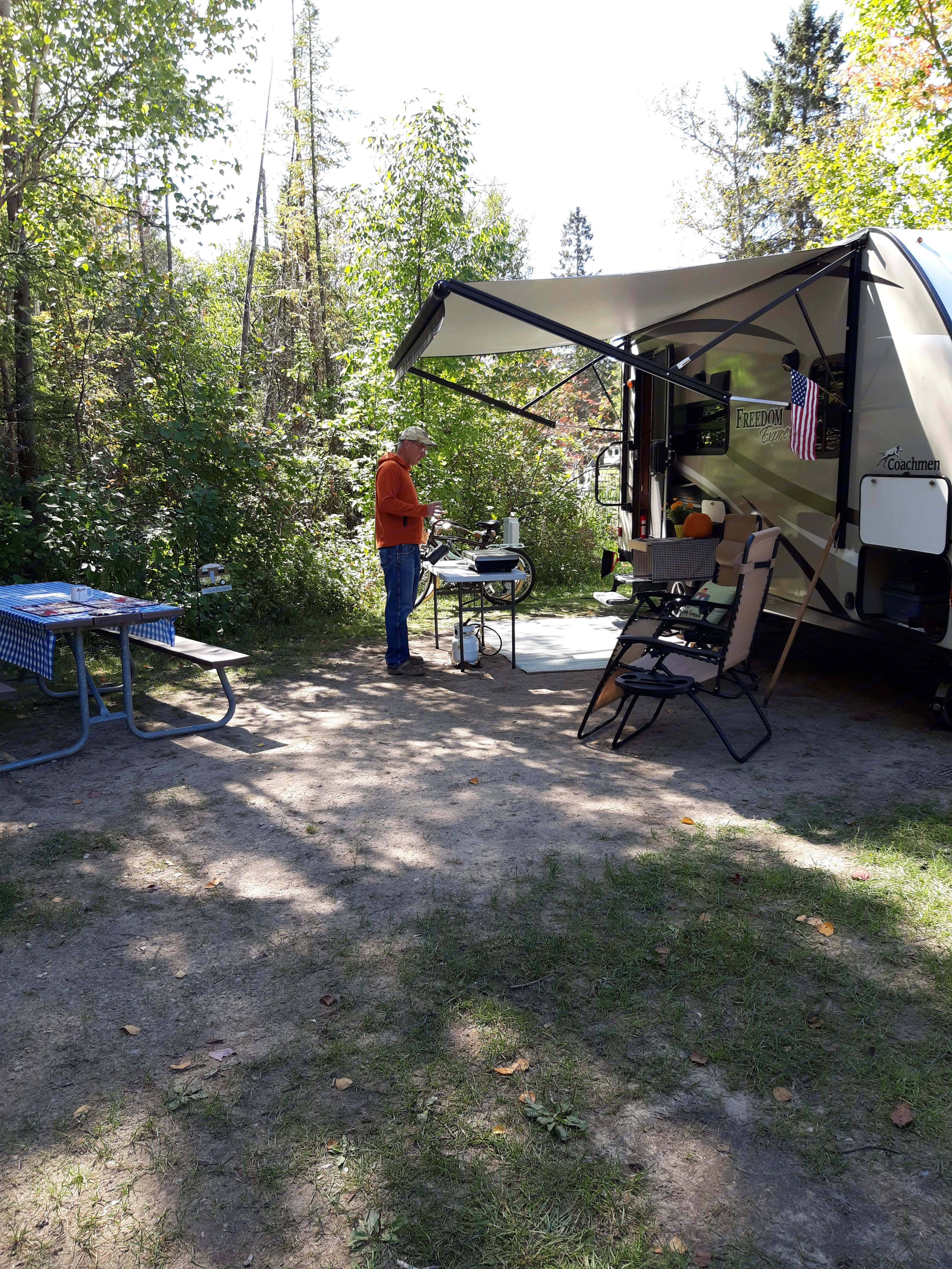 Enjoying the fresh air dining and living 'room'!. Coachmen Freedom Express 2018
