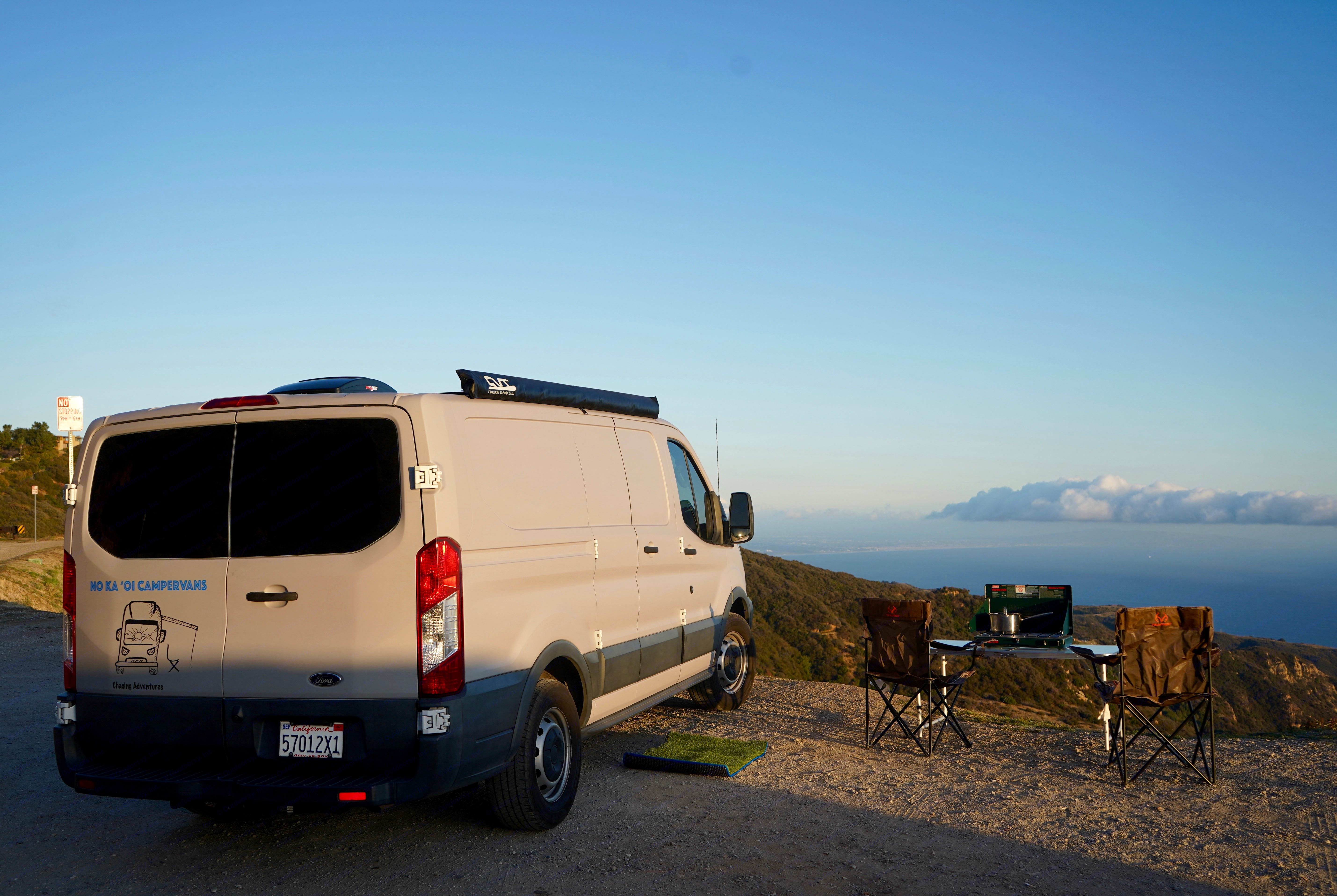 Two chairs, table and coleman burner perfect for a sunset anywhere!. Ford Custom Transit 2016