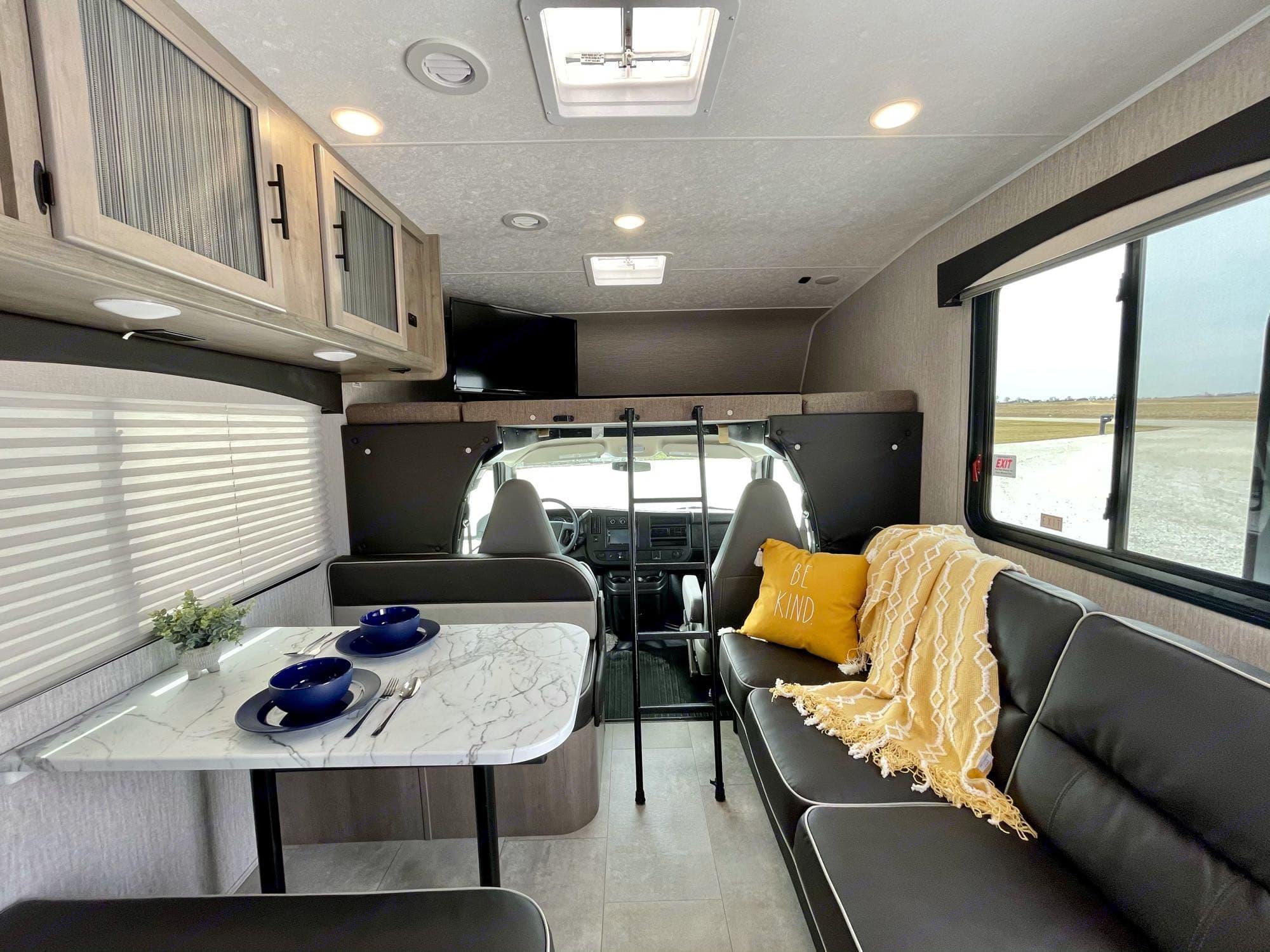 living area. jackknife sofa, dream dinette, overhead bunk. Coachmen Freelander 27QB 2021