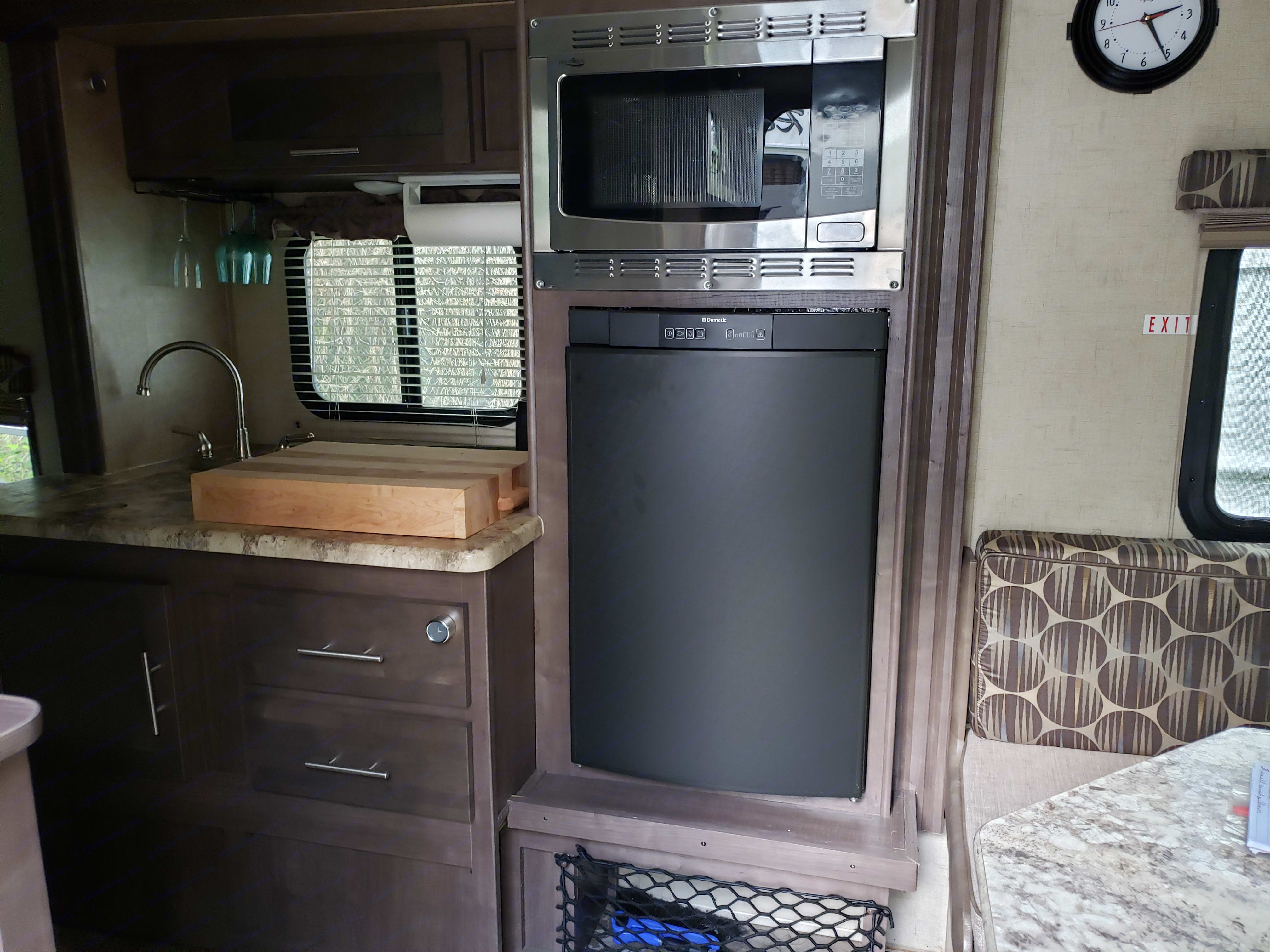 Kitchen with wood-block stove cover, nice sized refrigerator and convection oven.. Forest River R-Pod 182G 2017
