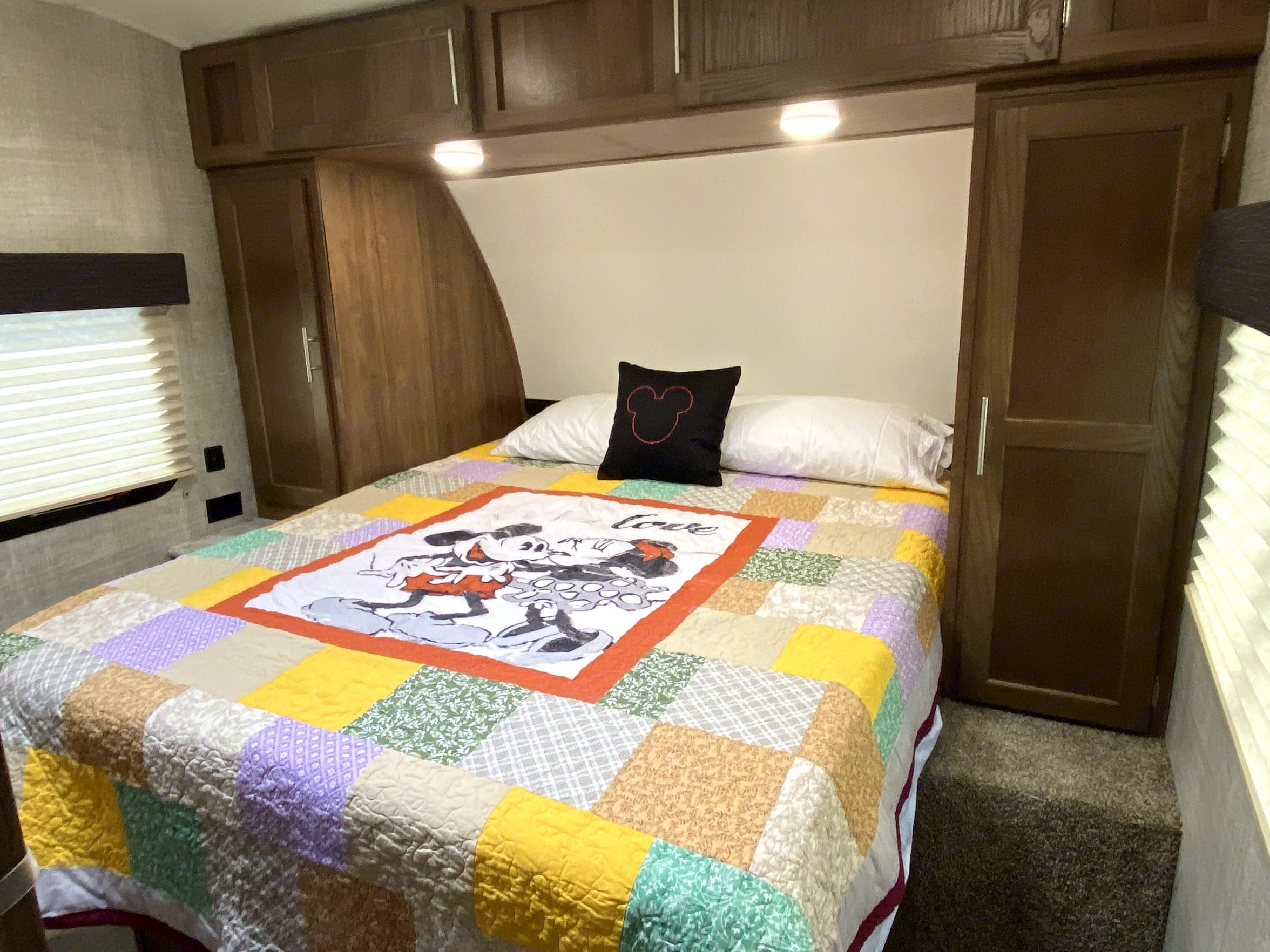 Queen bed with 4 inch memory foam mattress topper, hanging closet and sliding door for privacy.. Gulf Stream Innsbruck 2020