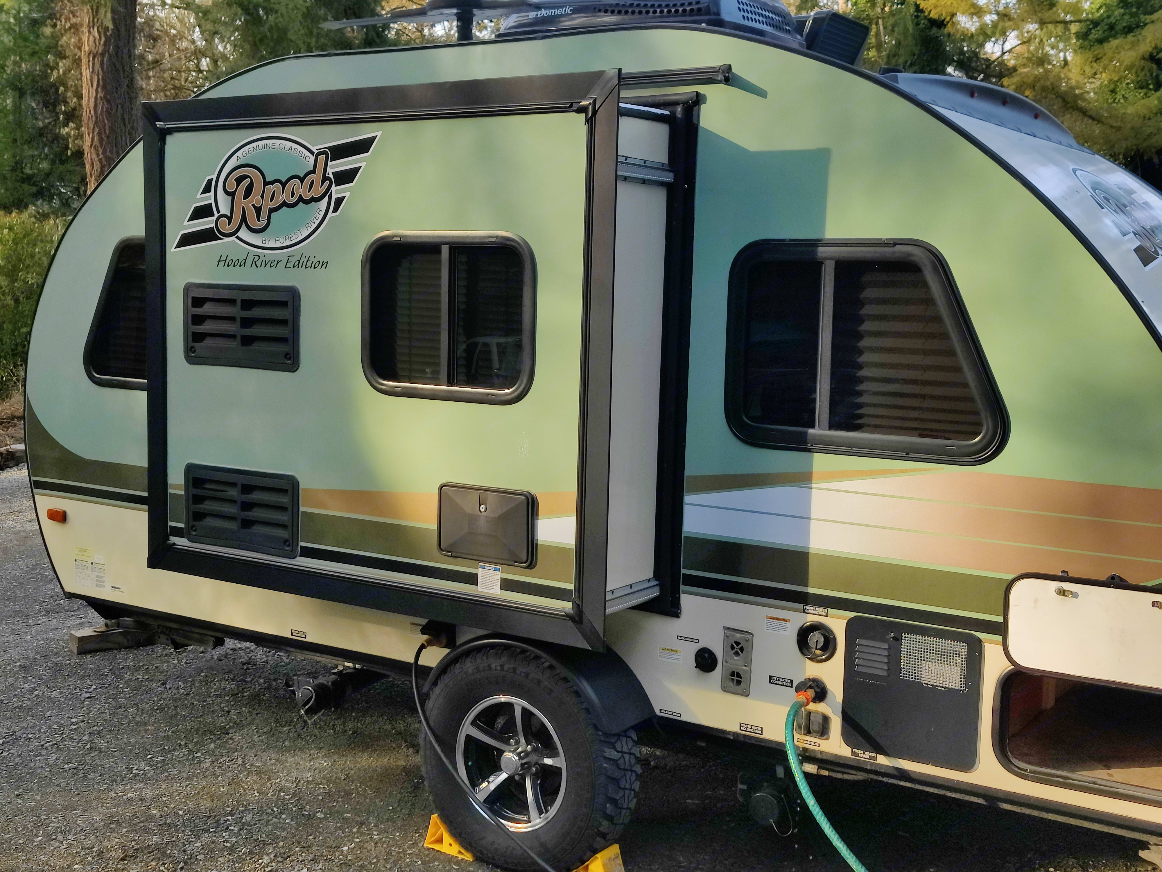 """The slideout gives an extra 18"""" of room inside. This makes a world of difference! Connections are easily made to your power and water sources.. Forest River R-Pod 2016"""