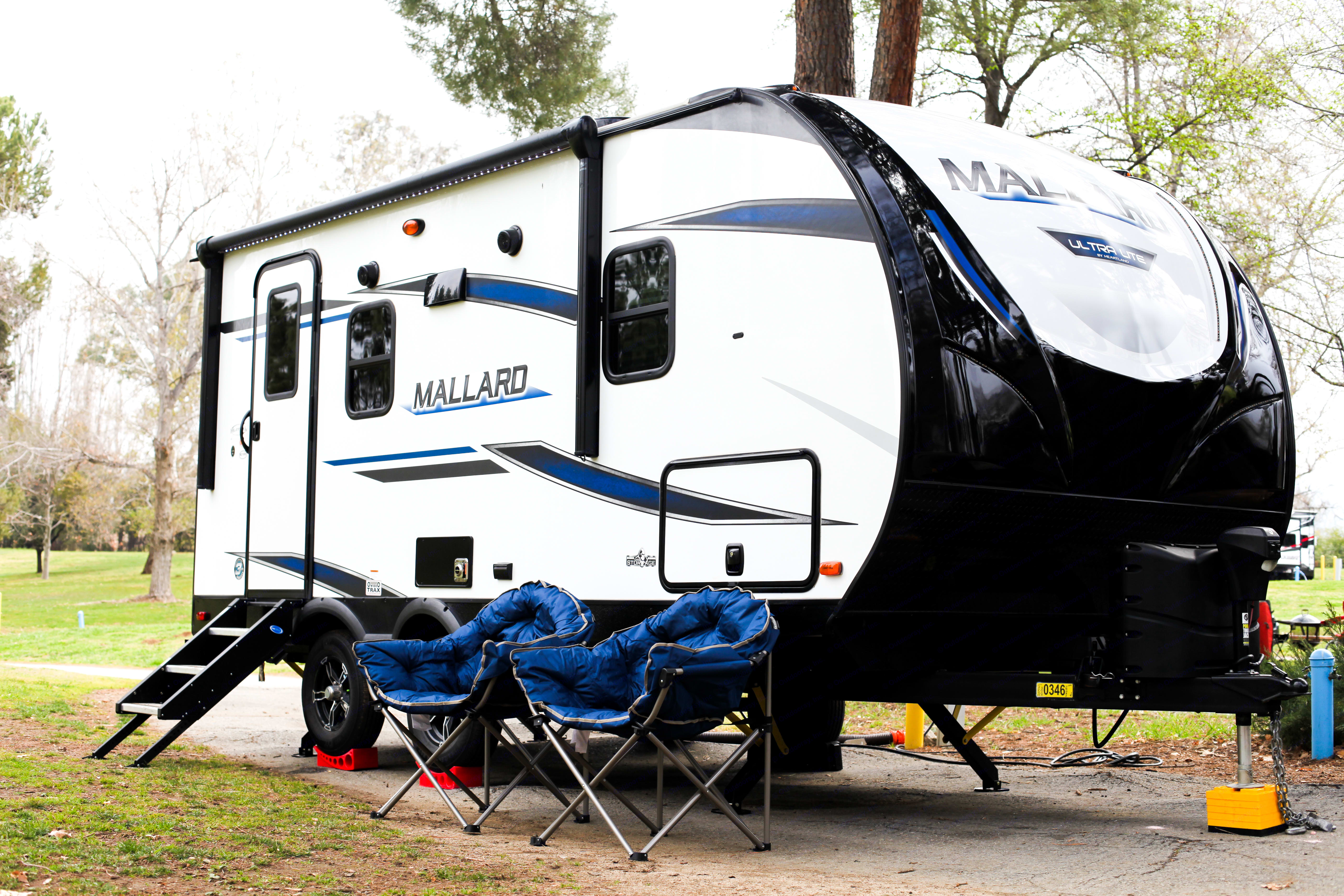 Only 22 Ft  Thick insulation to keep you cool in the summer and warm in the winter. Rental includes 2 camping chairs!. Heartland Mallard 2020