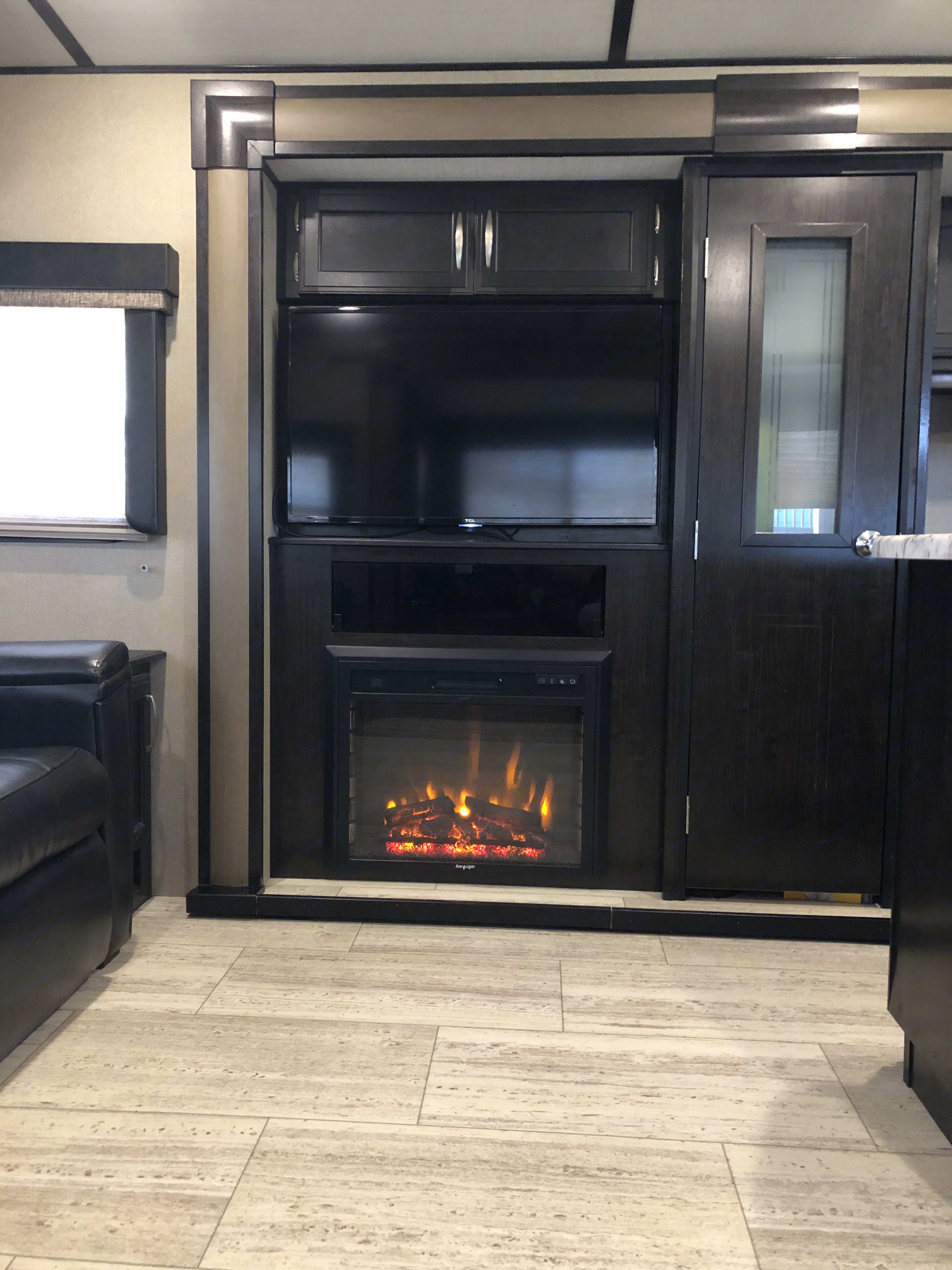 fire place can be used at different settings. just lighting or provide heat at 4 different settings. Grand Design Imagine RL2970 2019