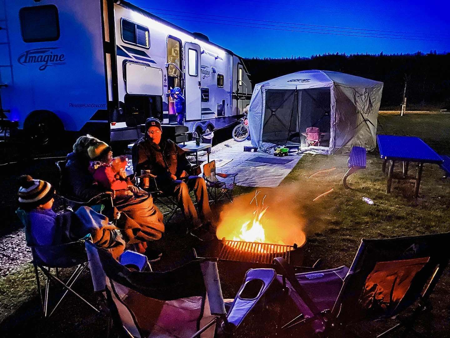 Cozy up around the fire with a little fall camping in MN. The clam shelter can be rented as well.. Grand Design Imagine 3000QB 2019