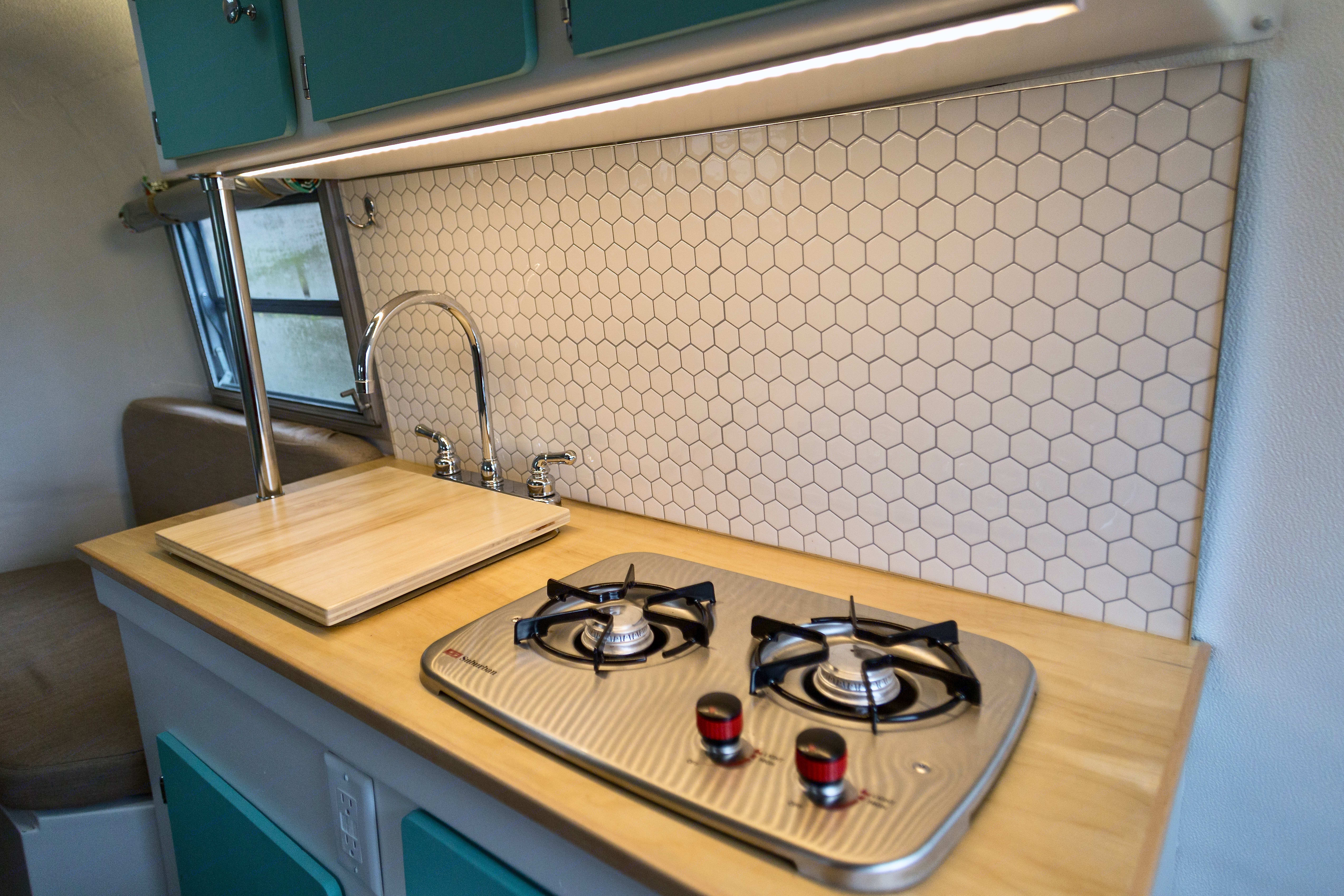 Under cabinet LED lighting, sink with electronic pump and gas cooktop. . Boler 13' 1975