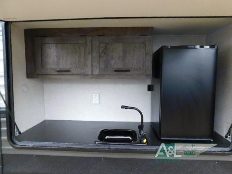 Outdoor kitchen area with sink.  Great for outdoor cooking.. Forest River Salem 2020