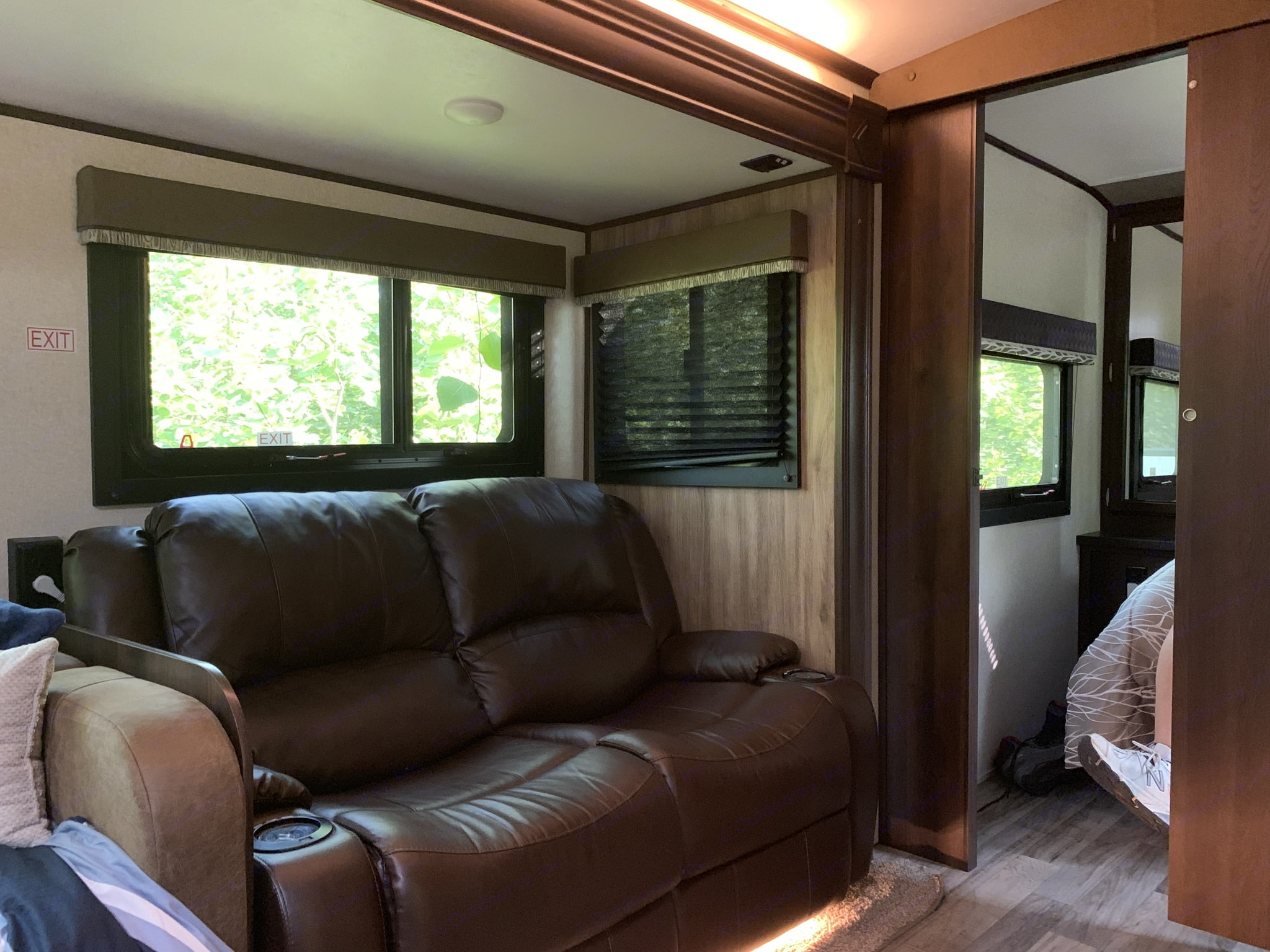 Power reclining loveseat with USB cup holders directly across from TV. Jayco White Hawk 29Bh 2018