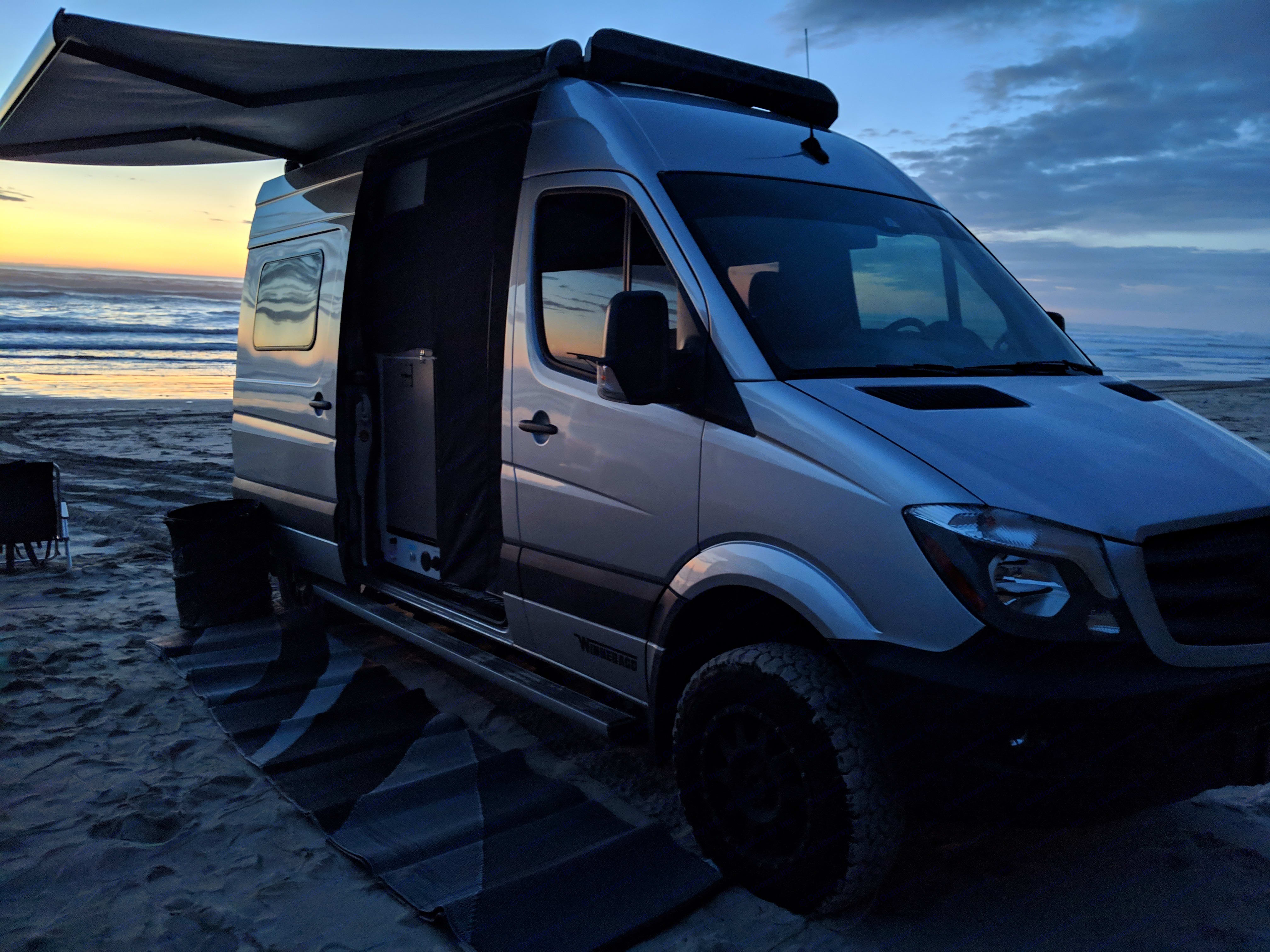 Large awning, fold down outdoor table by the slide door (not shown). Mercedes-Benz Sprinter Winnebago Revel 2019