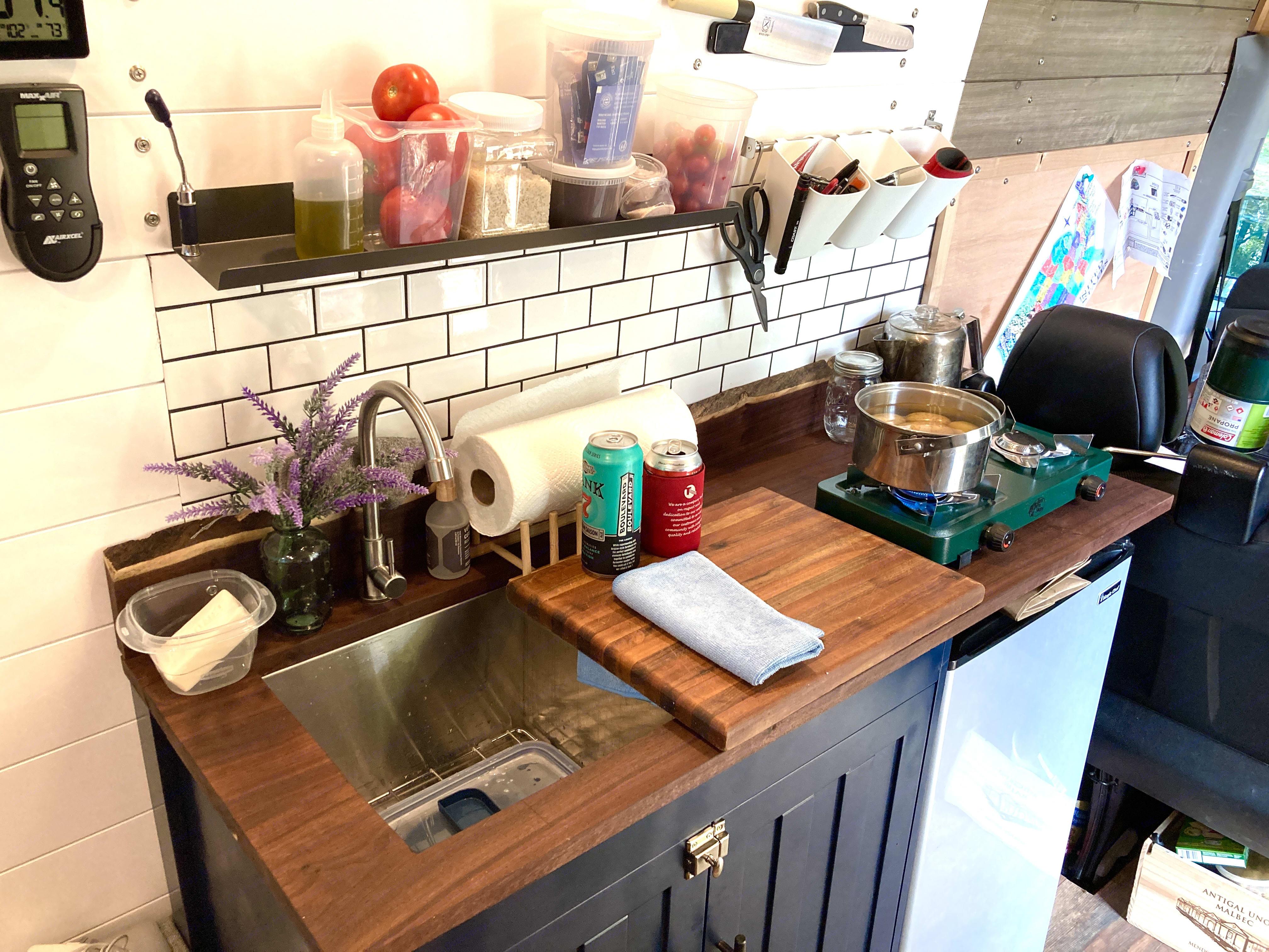 "Kitchen includes sink, cabinet, dorm fridge, and both a one-burner butane and two-burner propane camp stove.. Mercedes Sprinter 3500 XD 170""WB 2017"