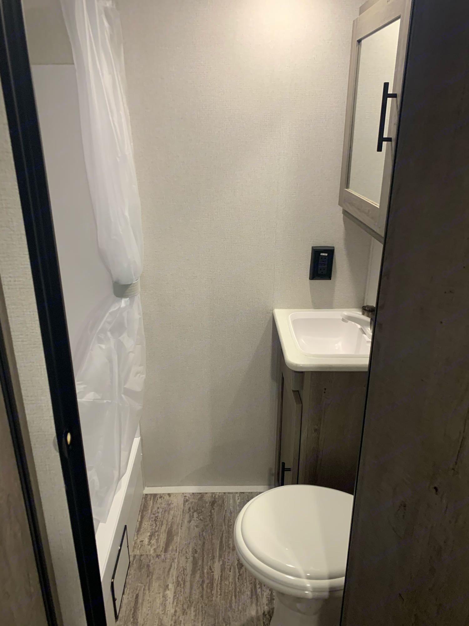 bathroom with shower, toilet, and sink. lots of storage!. Keystone Springdale 2021