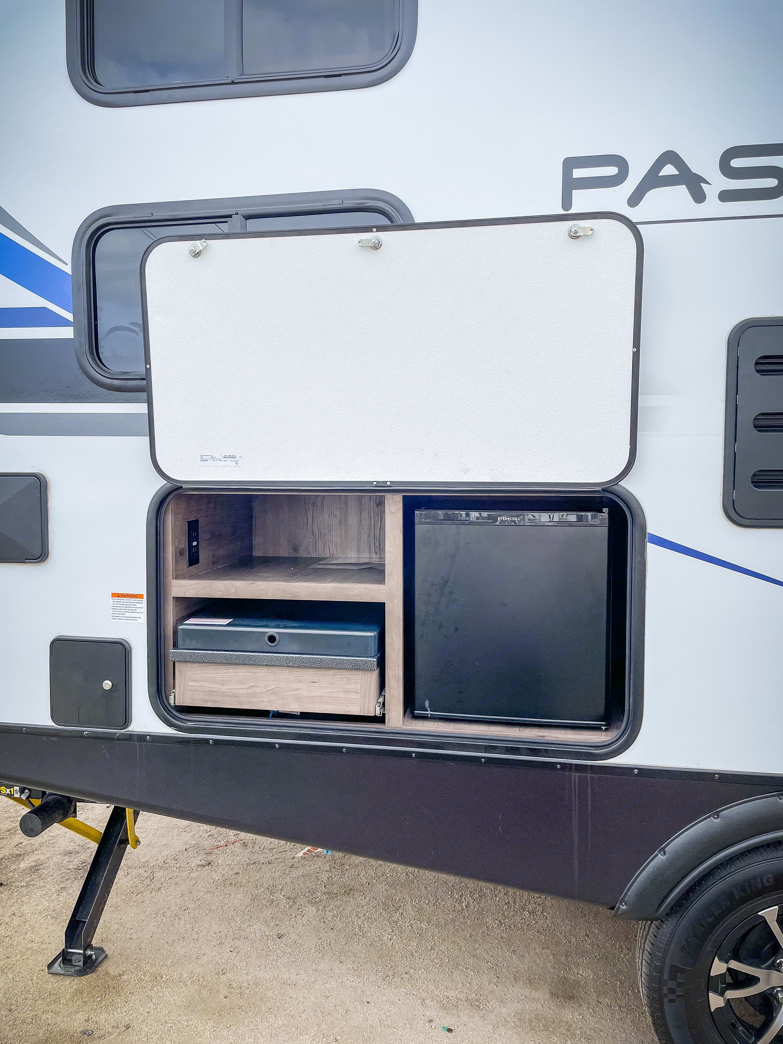 Outdoor fridge and gas grill keeps the party going outside. . Keystone Passport 2021