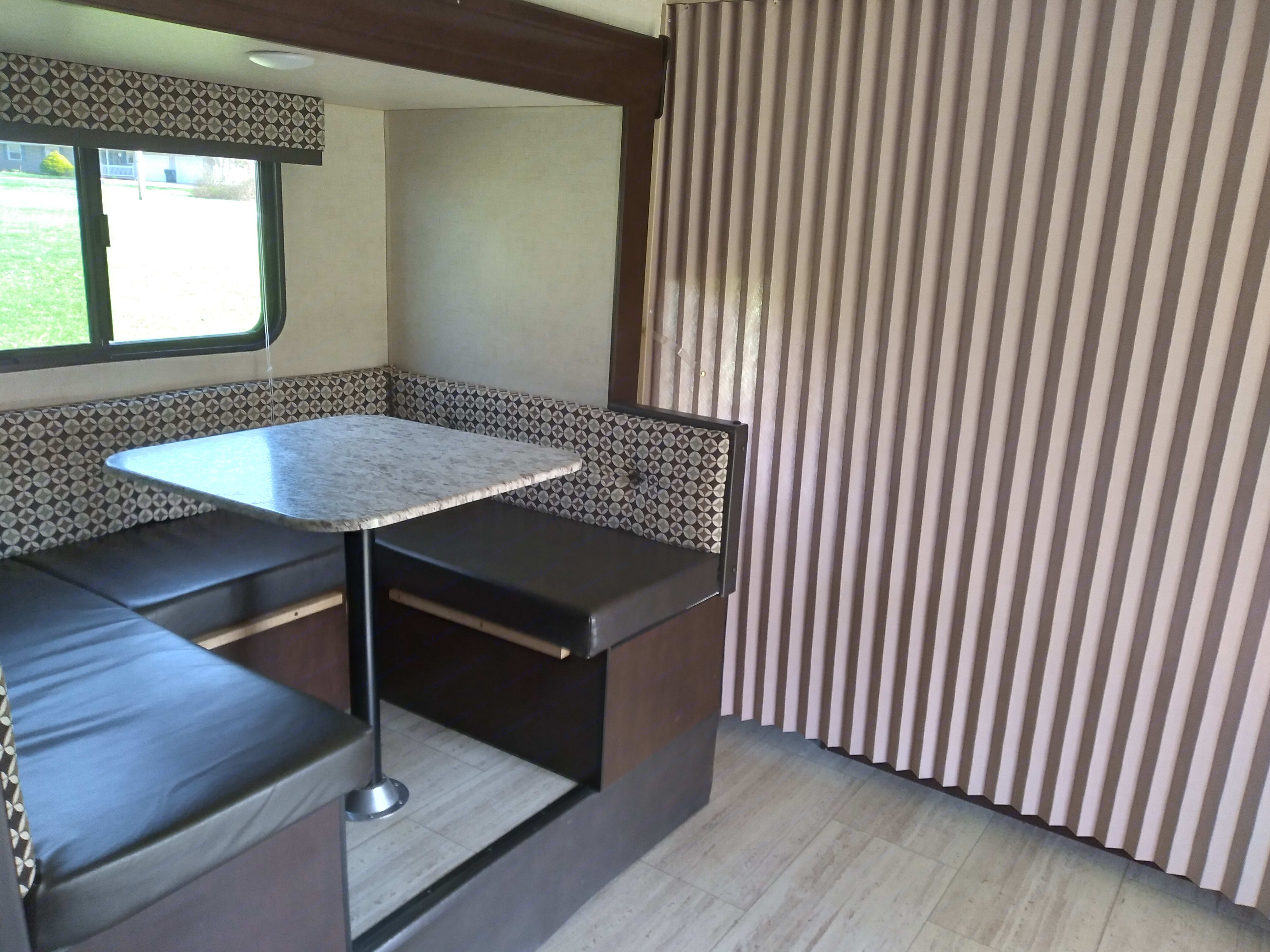 The dinette with the privacy screen pulled for the bedroom.. K-Z Manufacturing Sportsmen 2017