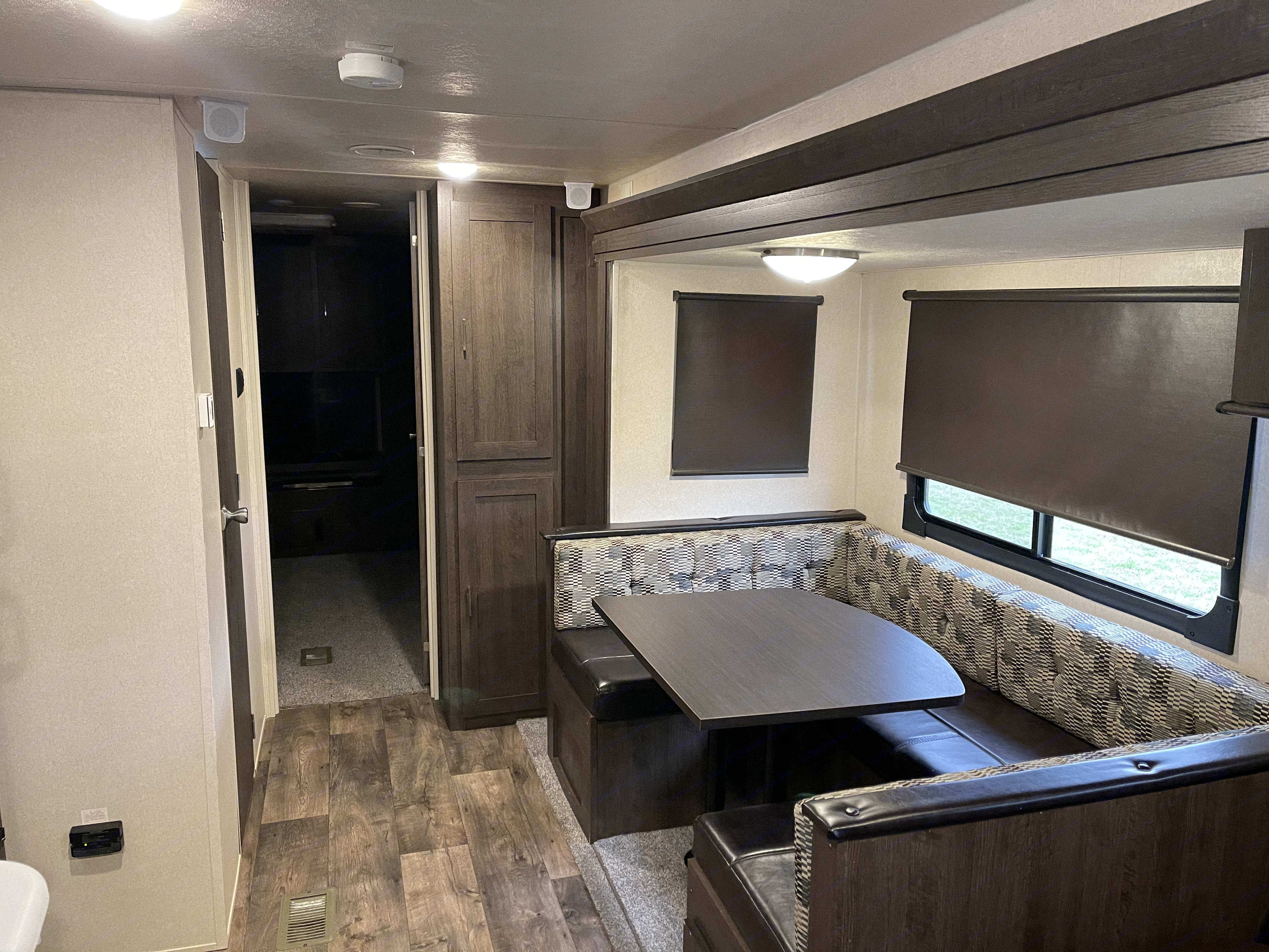 Dinette table converts into a bed that sleeps 2 adults or a few kids : ). Forest River Wildwood 31KQBTS 2018