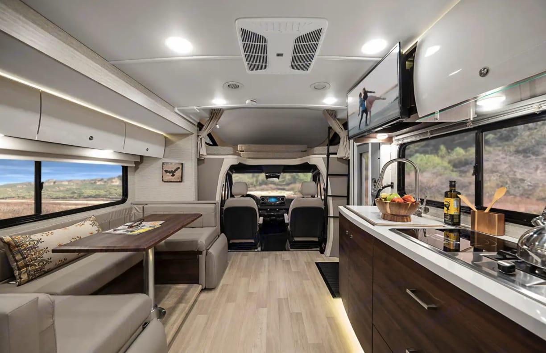Plenty of living space, warm colors. Winnebago Avion View 24D 2021