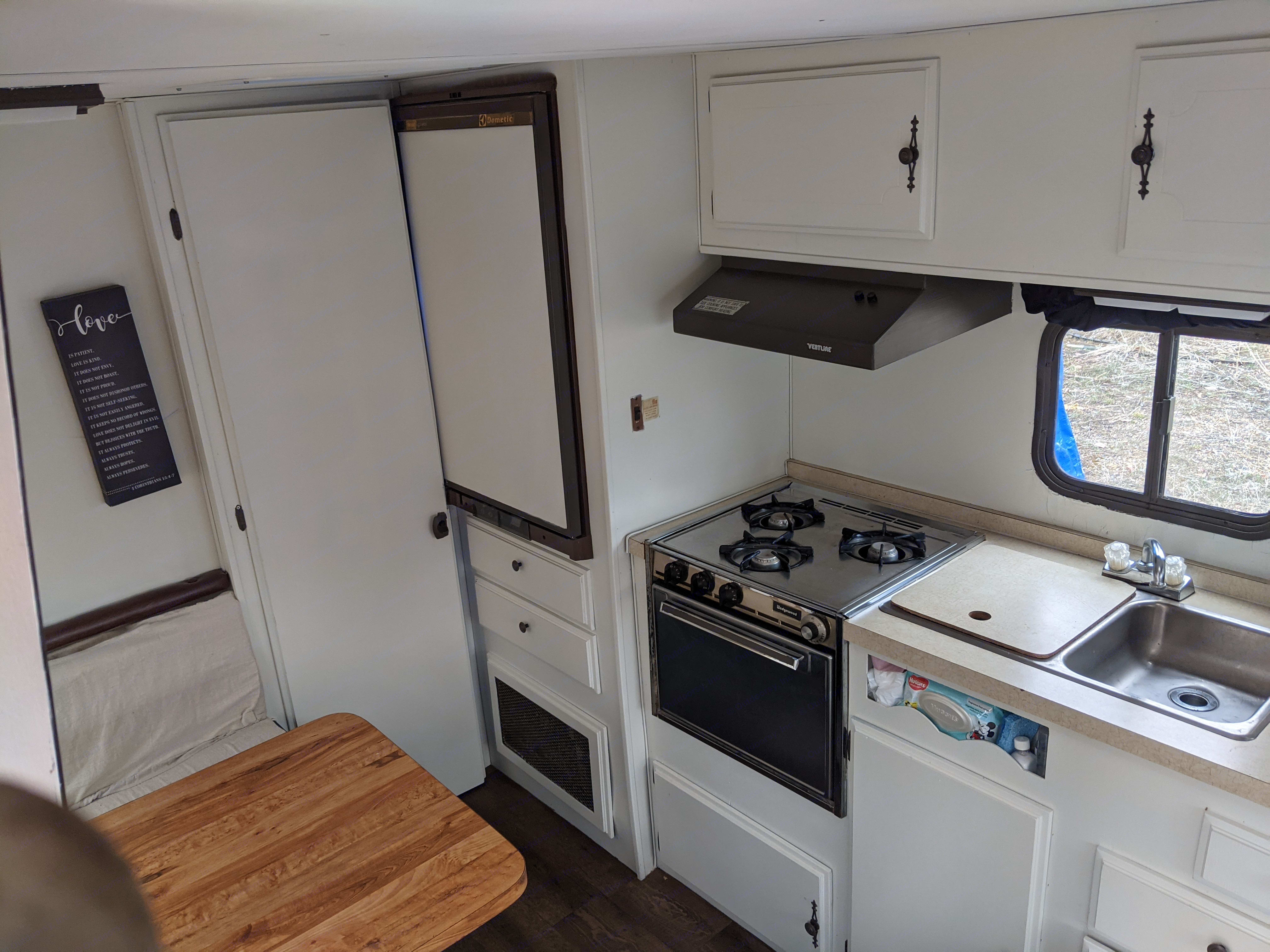 Refrigerator torwards the back.  Oven and stove just right of that, along with the sink.. Nomad Rear fold 1982
