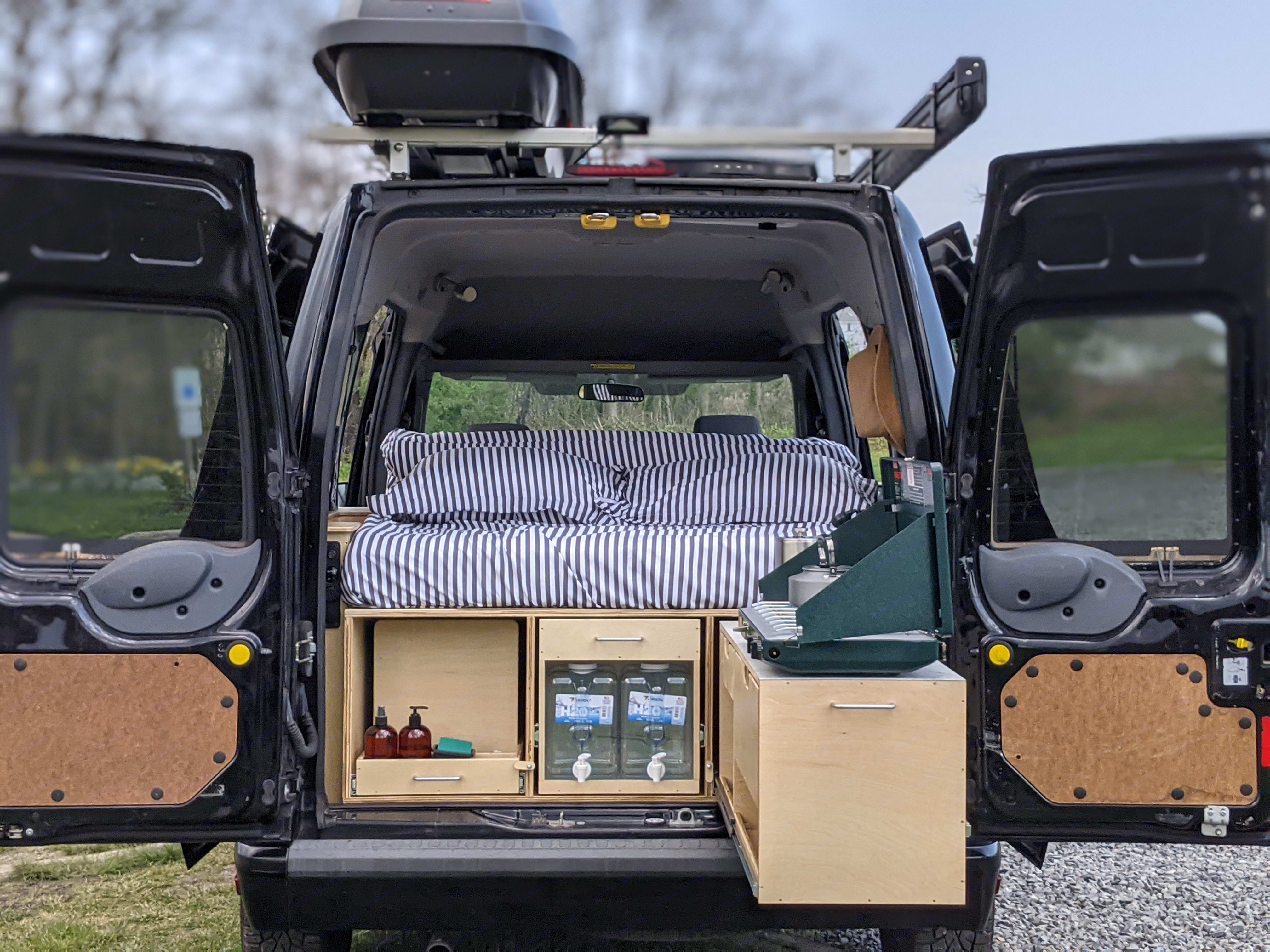 Elevate your next camping experience with a vehicle, queen sized bed, kitchen and storage all in one petite package. . Ford Transit Connect 2012