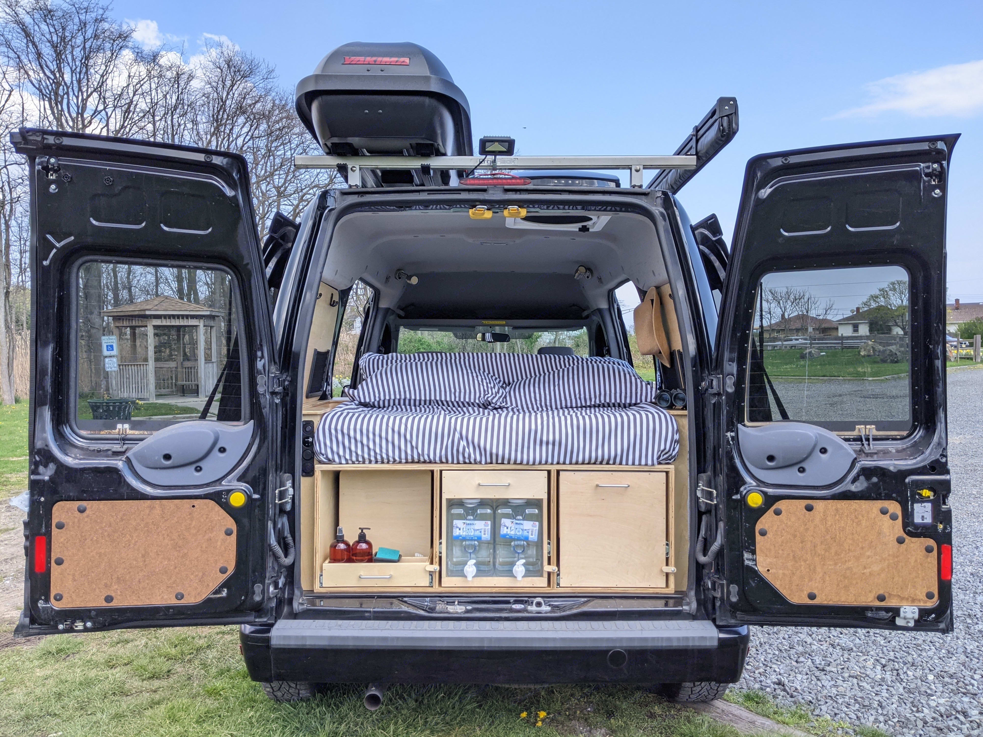 Don't let Ellie's petite size fool you! She has everything you need to elevate your camping experience: vehicle, queen sized bed, kitchen & storage. Ford Transit Connect 2012