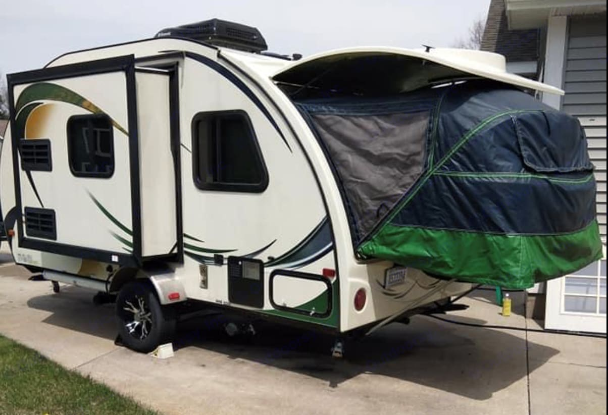 The slide out moves the kitchen out, greatly increasing the living space inside the POD. The tent is where the fold-out bed is contained.. Forest River R-Pod 2014