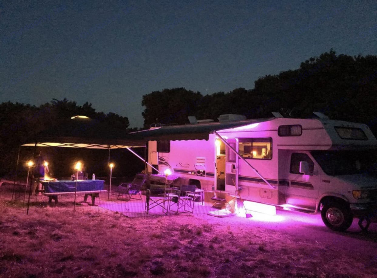 LED's glowing and pet enclosure setup. Coachmen Santara 1999
