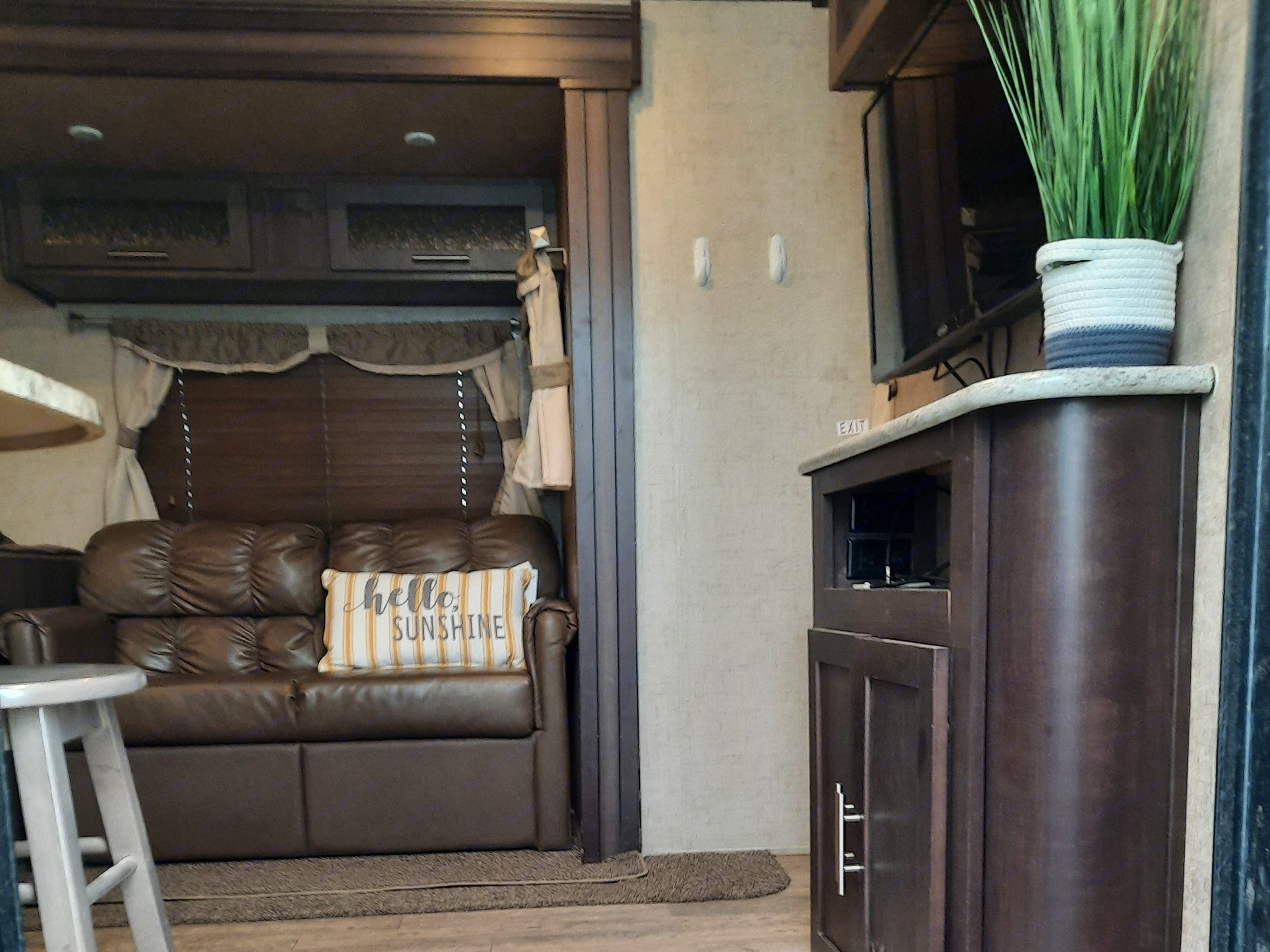 This is the view from the entry.  TV, Surround sound, comfy sofa.. Forest River Surveyor 2016