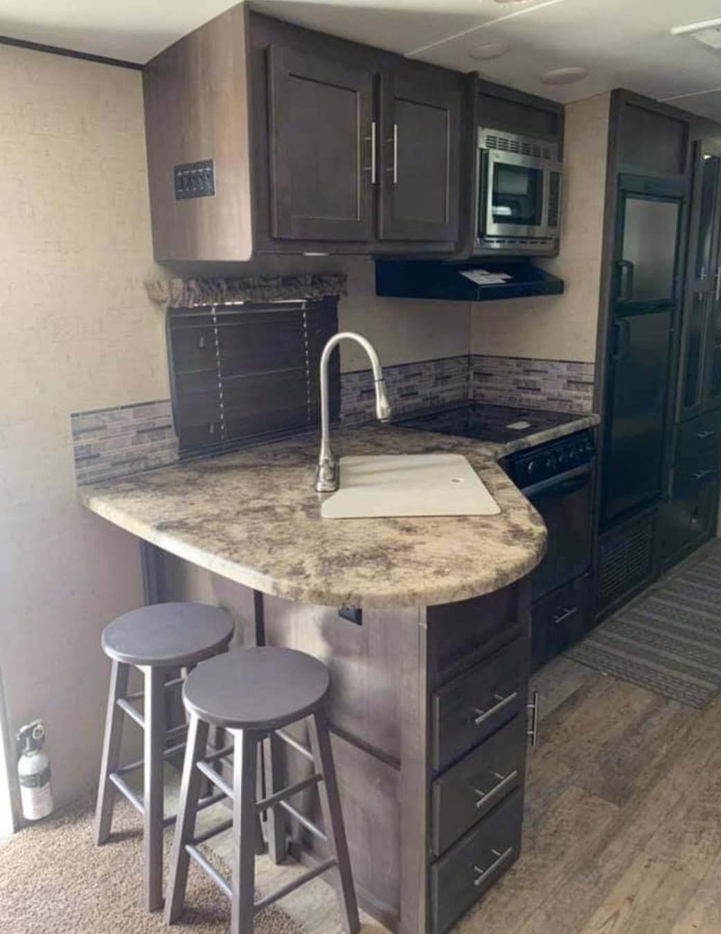 extra space for dining at the bar. Forest River Surveyor 2016