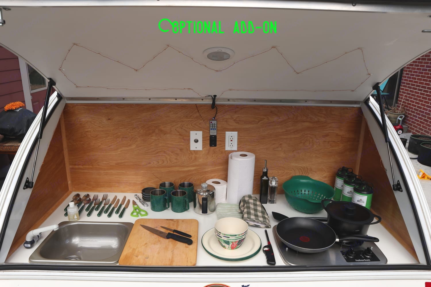 Built-in sink and stove come standard; cook-and-tableware are optional.. Little Guy Sport 6 Wide 2016