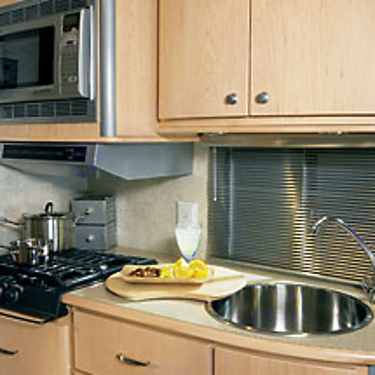 Kitchen area with storage for your dishes.  Has advanced water filter so that you may cook with or drink water based at your campground using the benefits of the advanced filter.
