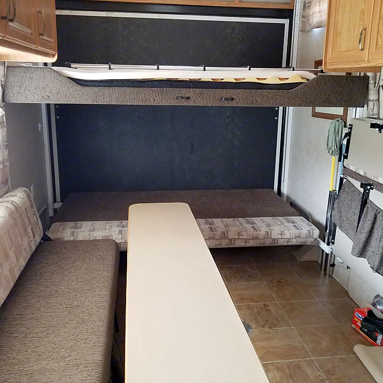 Side beds fold up to allow toy loading.11ft from loading door to first cabinet