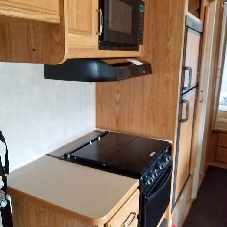 Stove and oven like new separate front bedroom in front of trailer