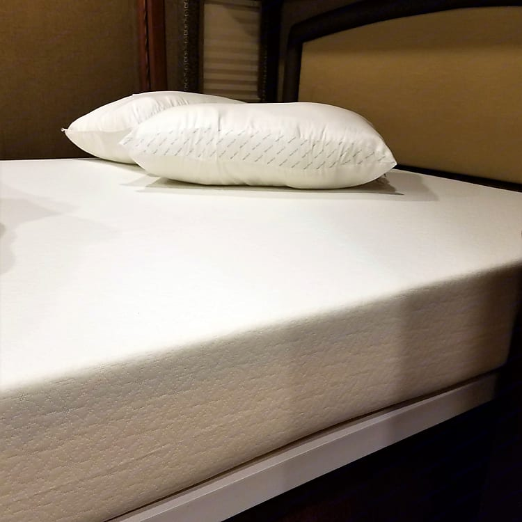 Replaced the factory mattress with a firm, 8 inch memory foam mattress in the bedroom. Sleep very comfortably, and wake up feeling refreshed.