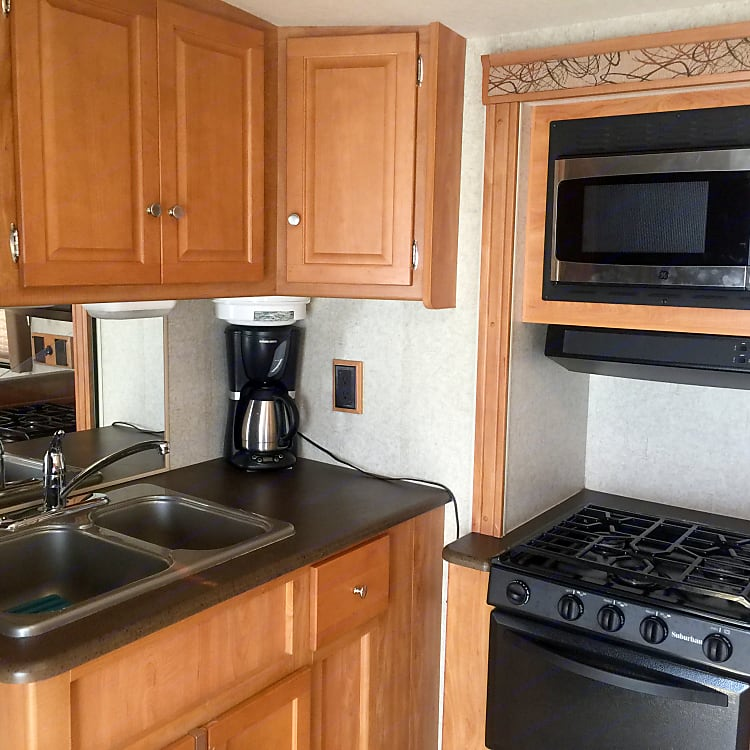 Kitchen area has dual sink, microwave, oven, stove, coffee maker, toaster and more. Fridge and separate freezer have more space than most RVs offer. Like having ice cream and kids like popsicles? Buy them both! There's room!