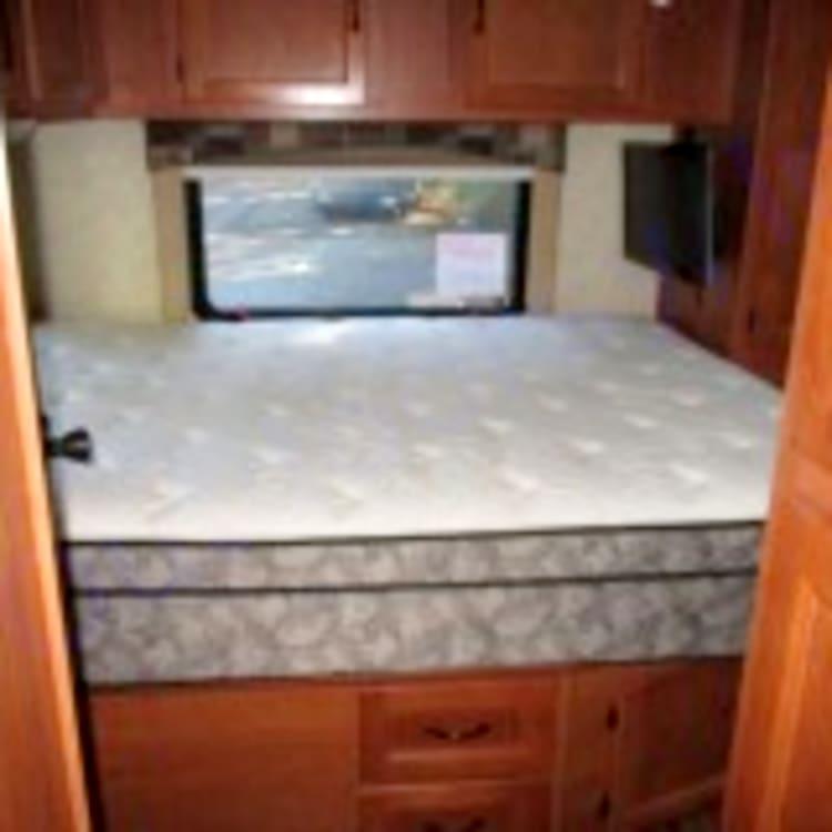 Queen bed in rear.