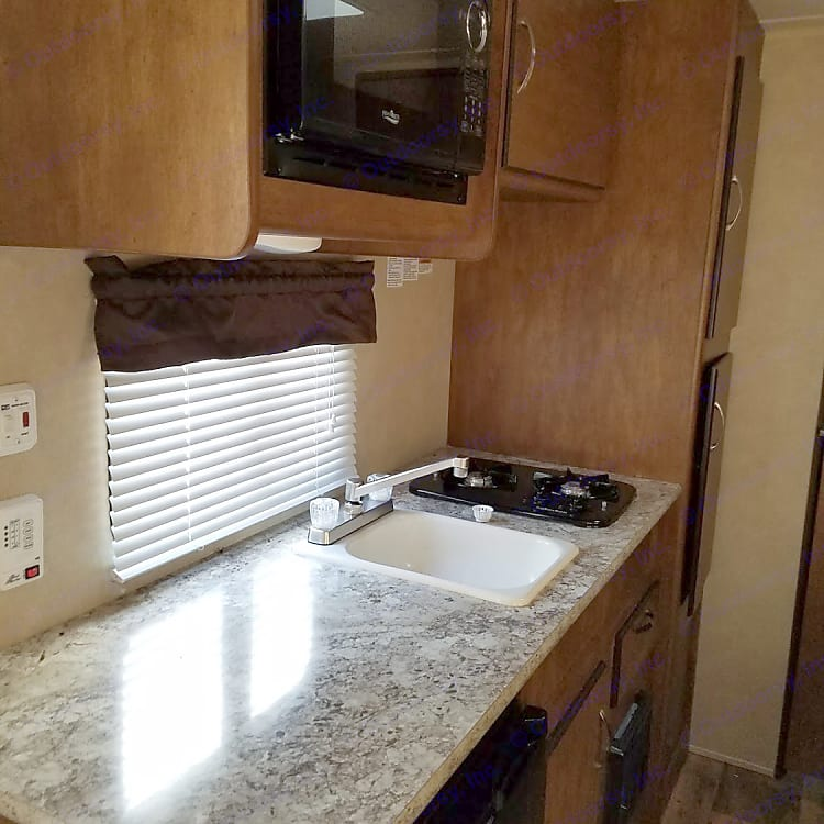 Full kitchen, 2-burner stove, fridge, sink, pantry and counter space.