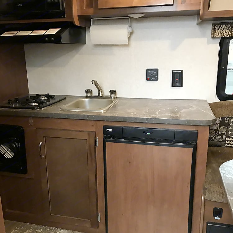 Kitchen with two burner stove, microwave,  sink & refrigerator (gas & electric)