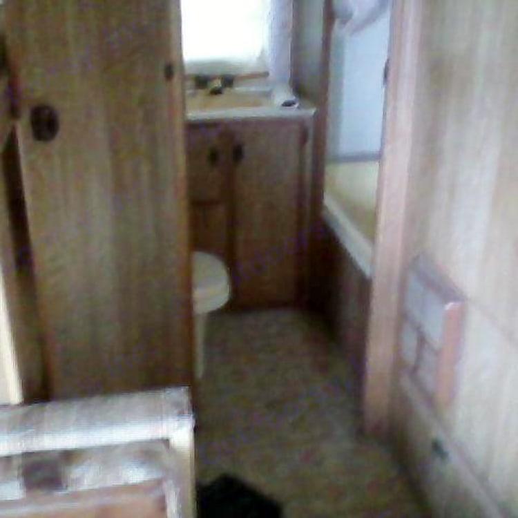Full bathroom with sink, toilet, bathtub and shower.