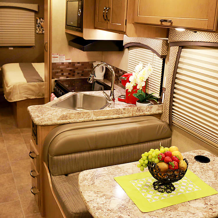 Interior showing dinette, kitchen and bed