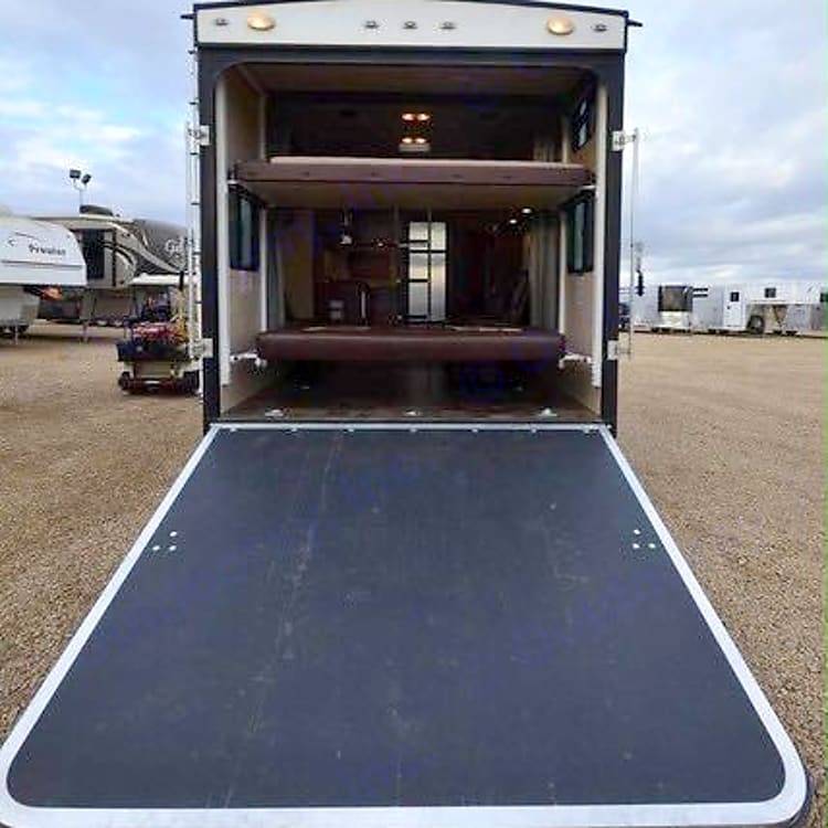 Deck/Ramp  & two bunk beds that can be electrically left out of the way
