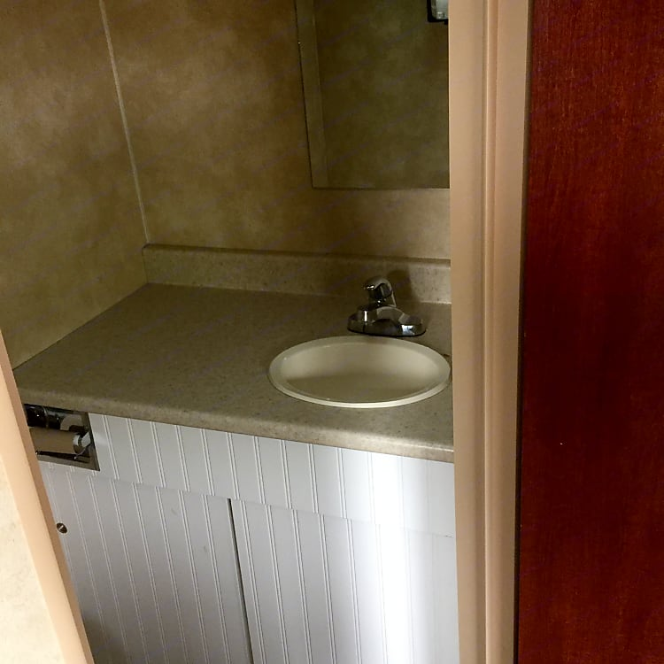there is no shower as the previous owner built in a small vanity and sink