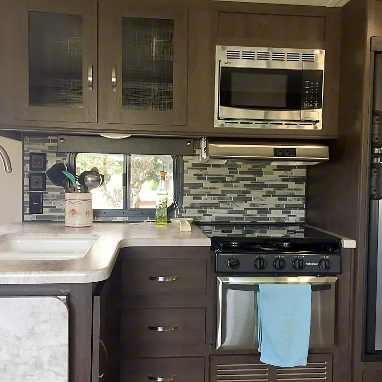 Kitchen has extra counter space, a 3-burner stove, and a double sink!
